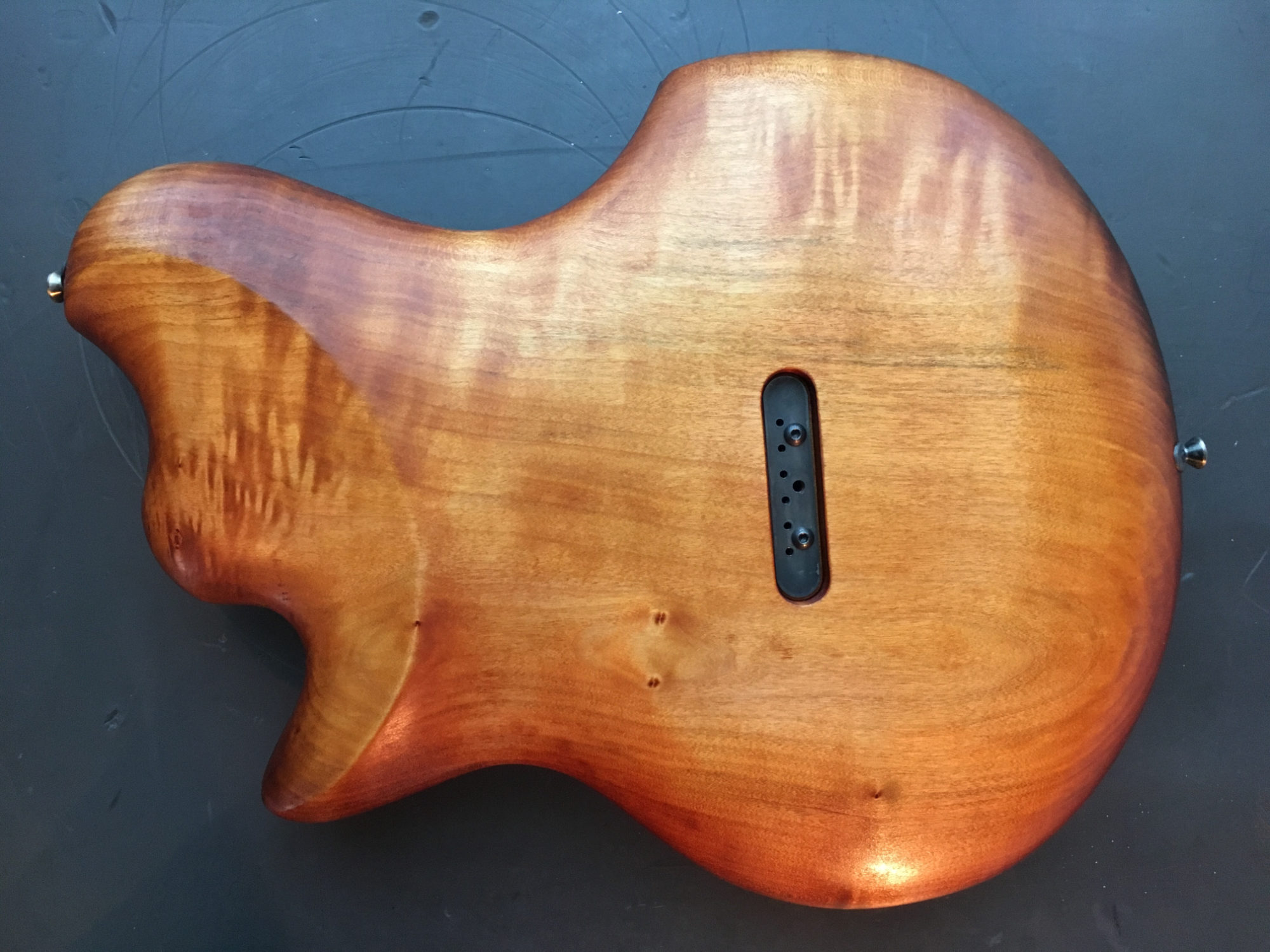 m-tone-riptide1-backbody-wood.jpg