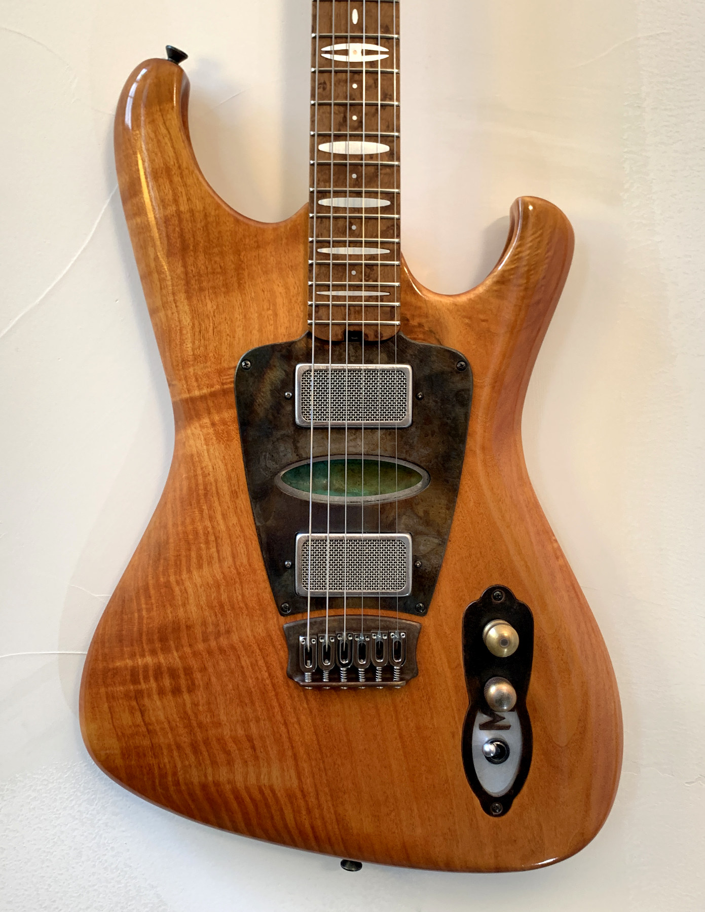 Hypersonic - The Hypersonic is a thinner double cut solid body guitar with a flush inlaid control plate and distinctive hollow routs in the horns.