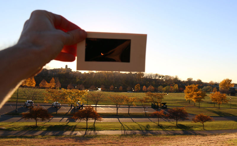 Figure 6-3: The image of a partially eclipsed Sun through a solar viewing card held at arm's length. Image credit: Tom Ruen/Wikipedia Commons.