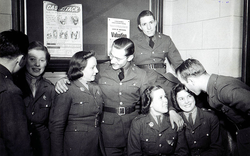 American soldiers and Irish girls chat during the Saint Patricks Day Dance and Celebration, 1942.