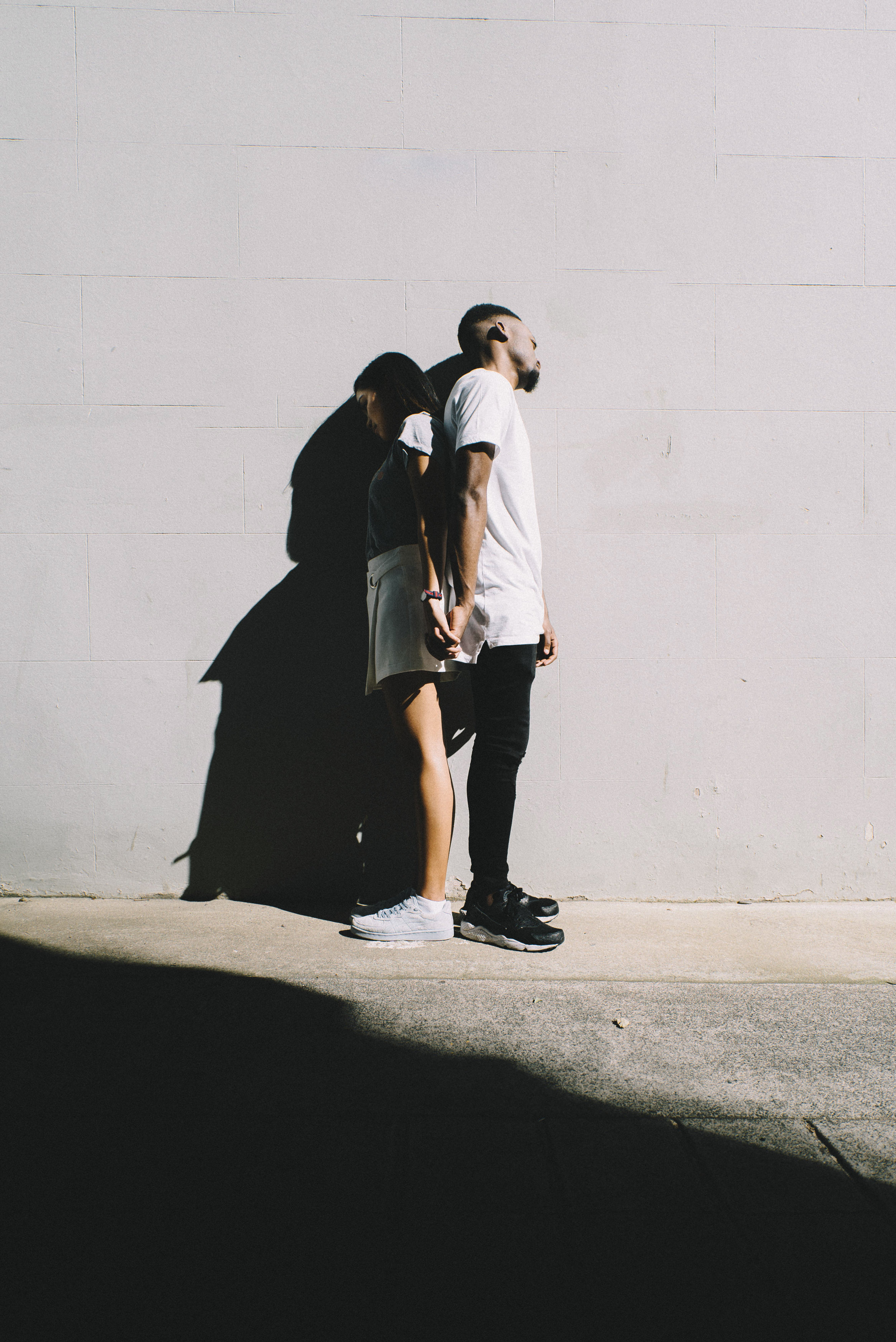 A couple in a relationship facing away from each other.