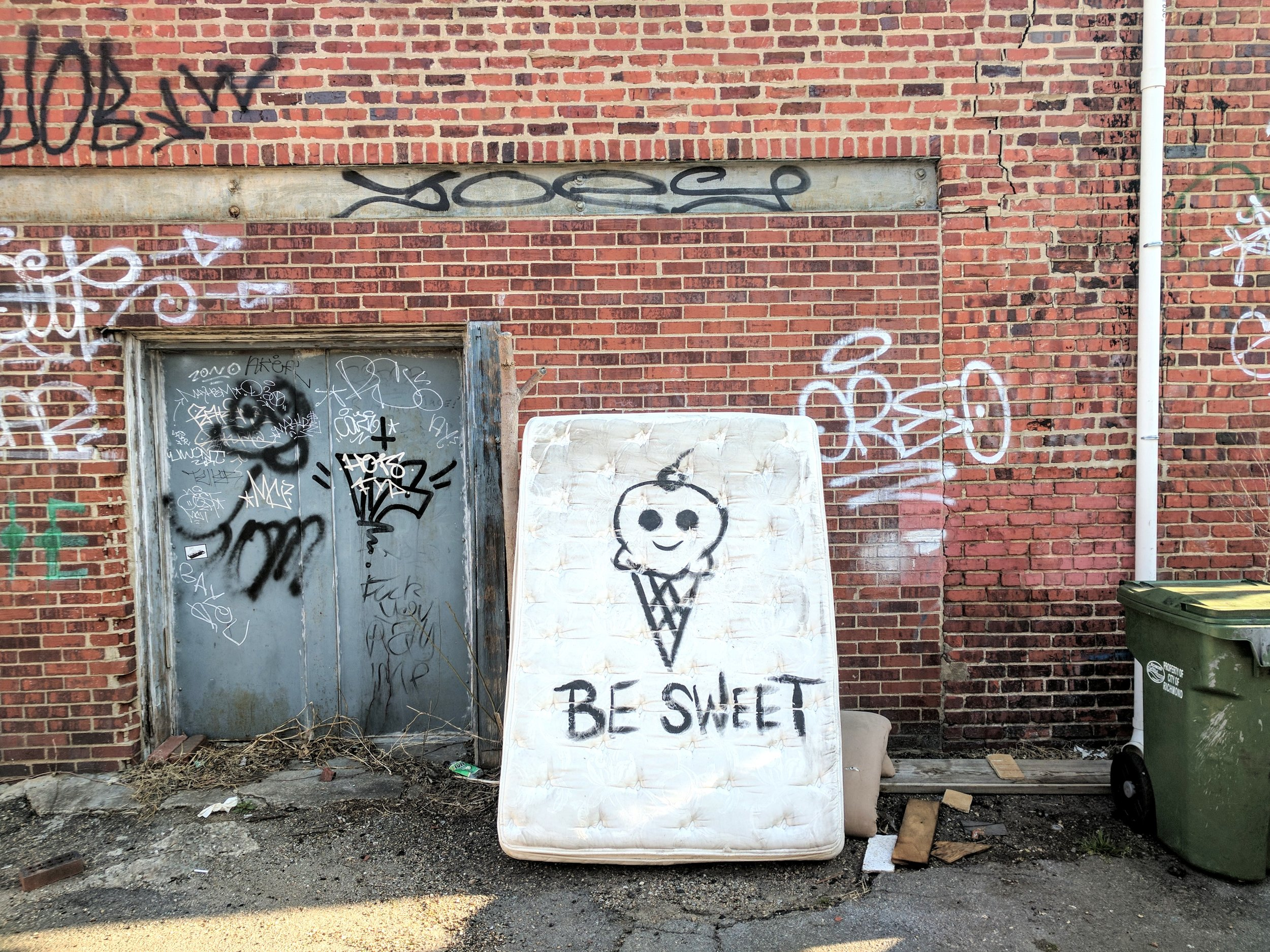 "Street art that says ""be sweet."""