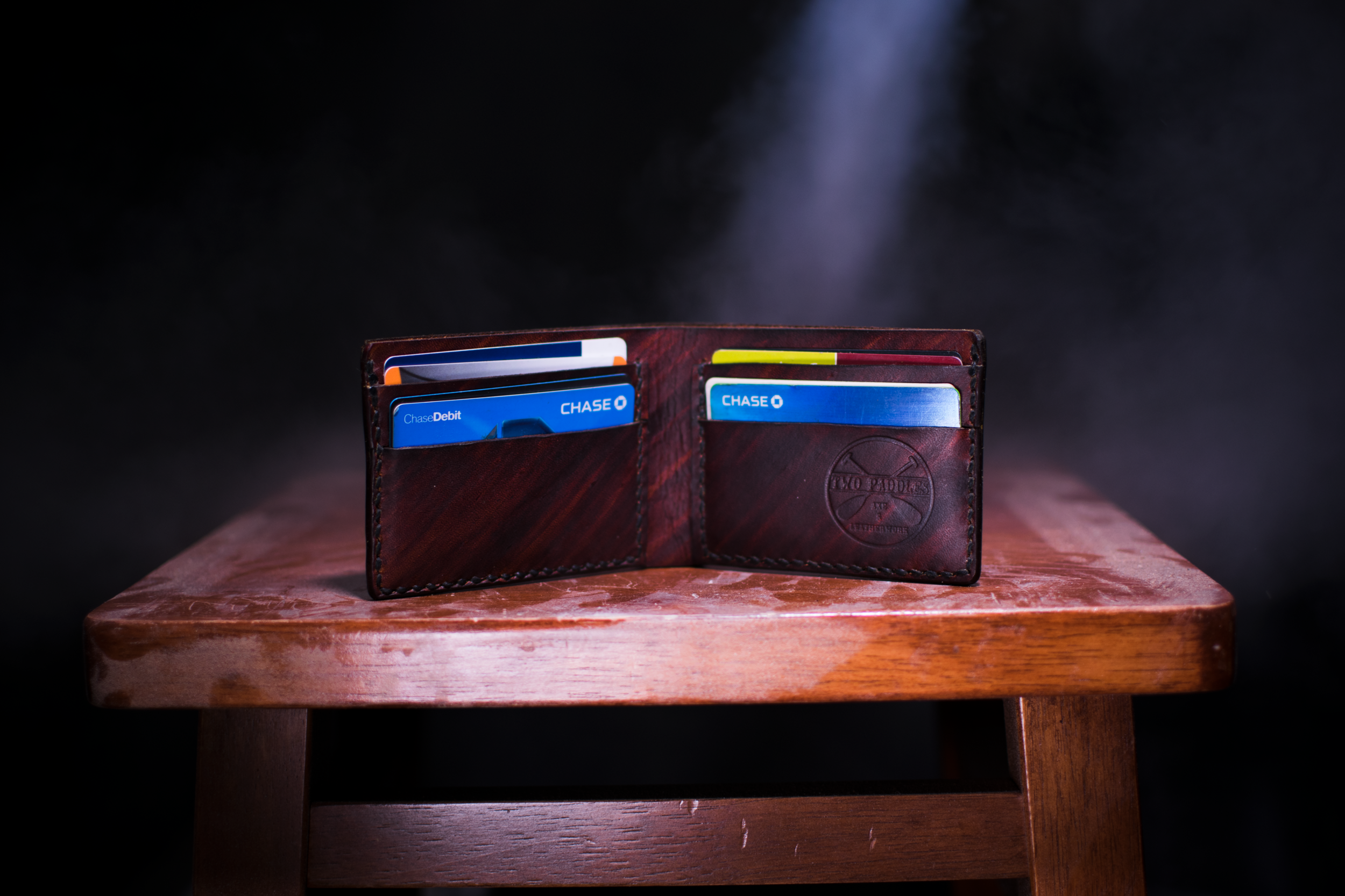 A wallet with credit cards in it.