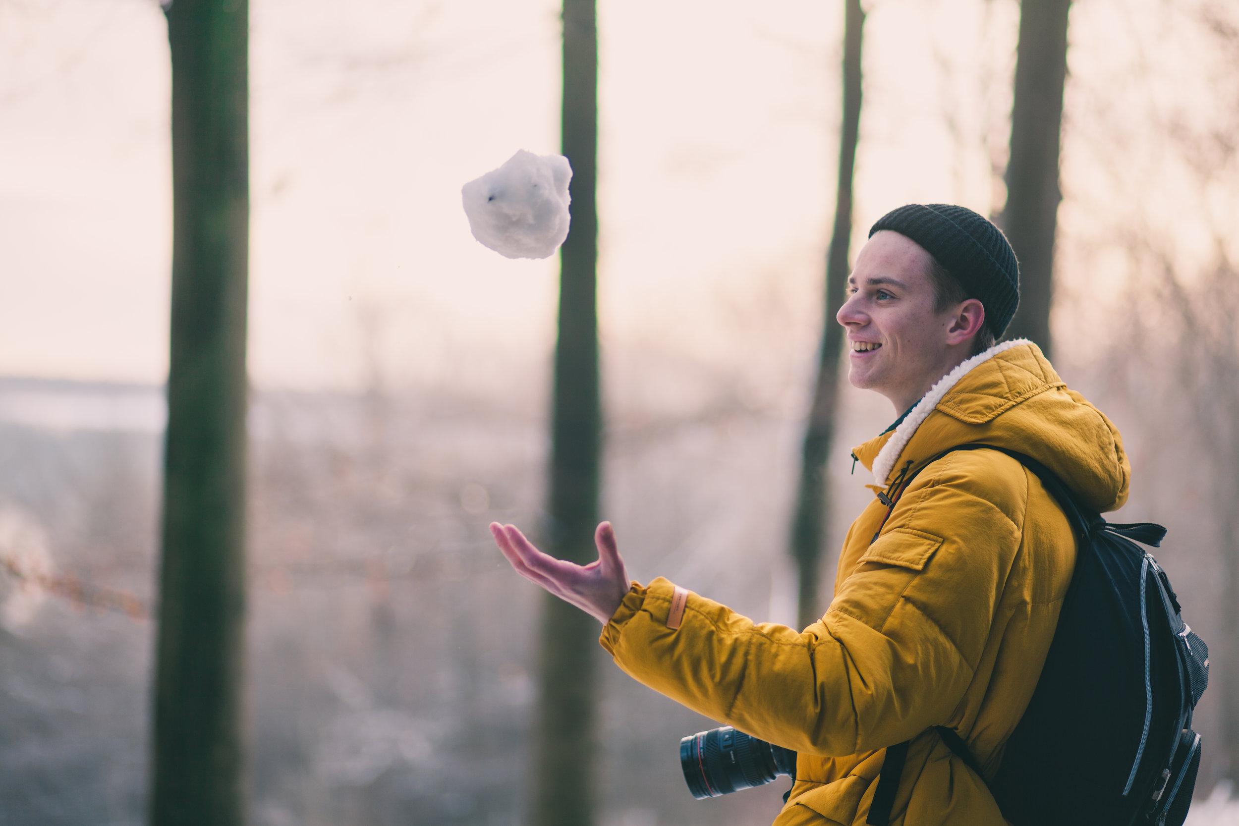 A man holding a snowball.