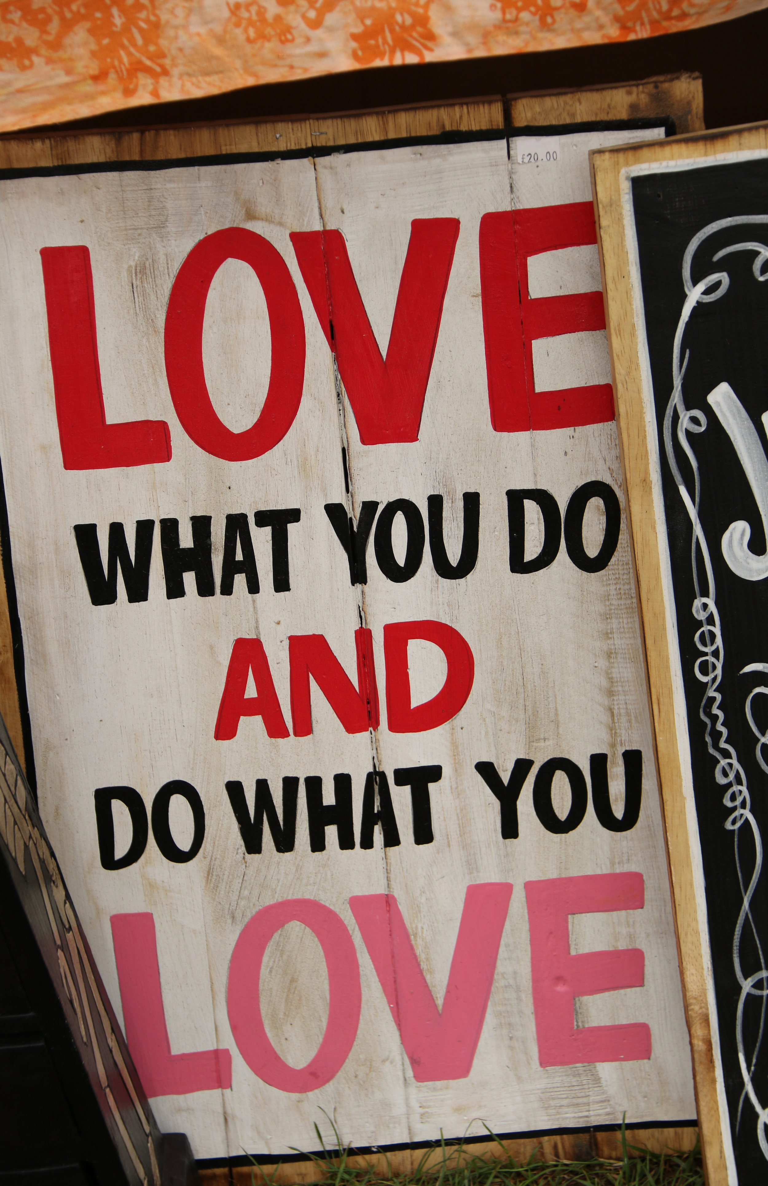 """A sign that says """"love what you do and do what you love."""""""
