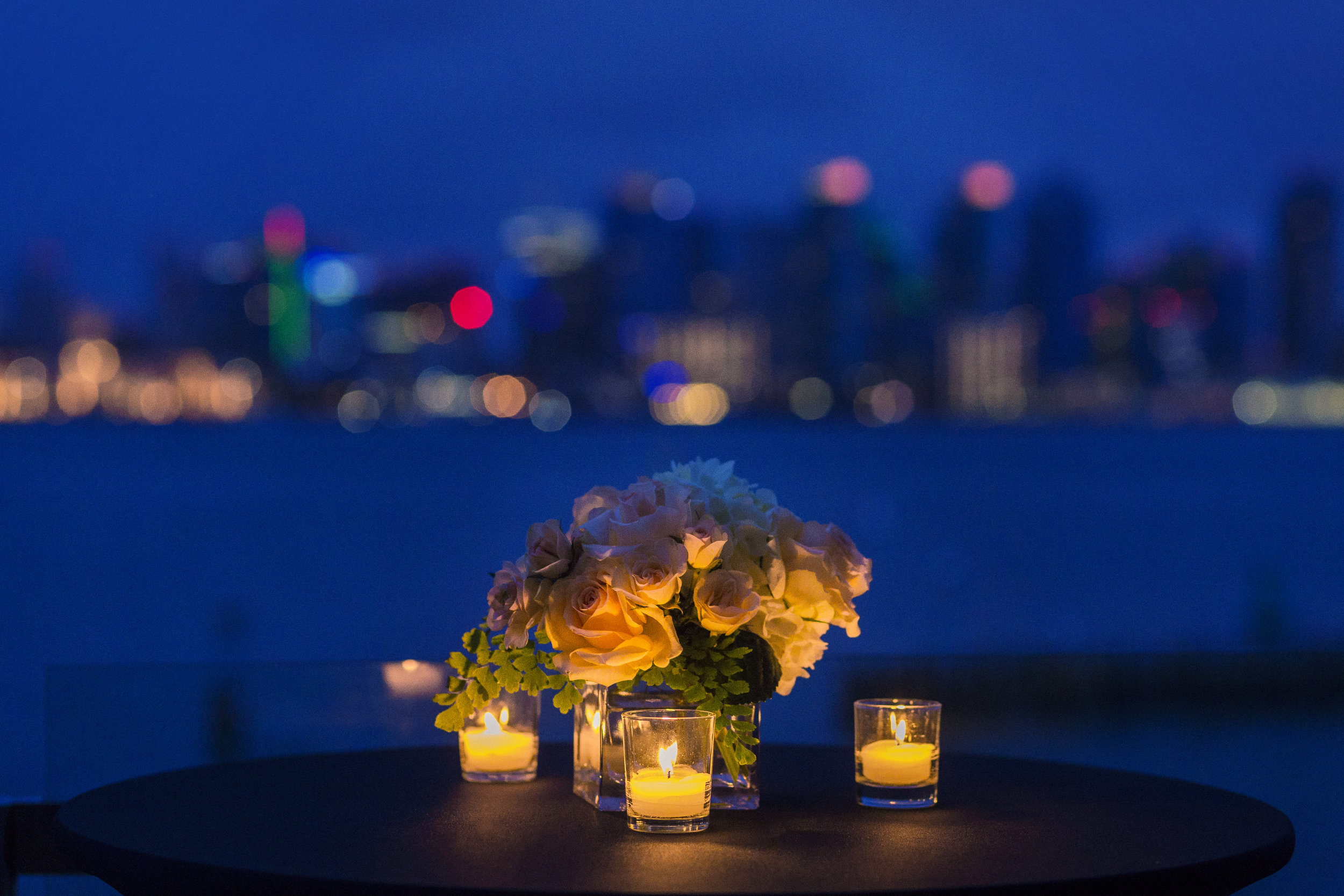 Flowers and candle on a table waiting for a date.