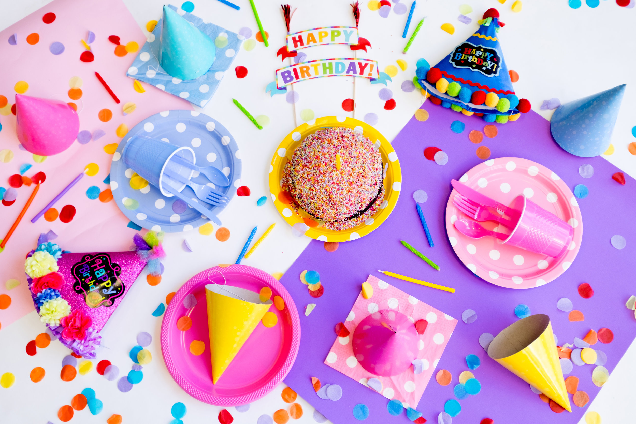 Table covered with birthday supplies