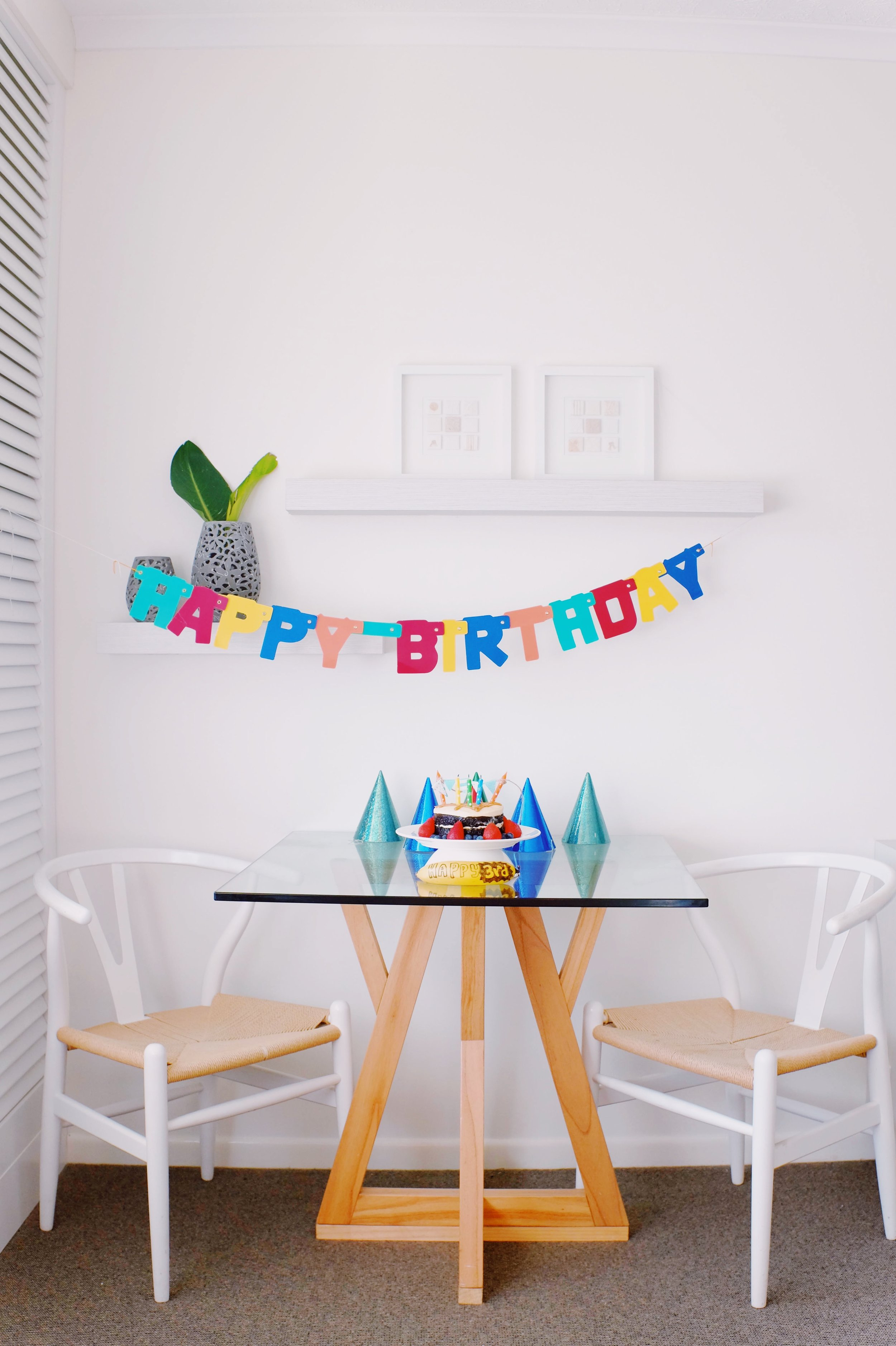 Birthday decorations against a white background