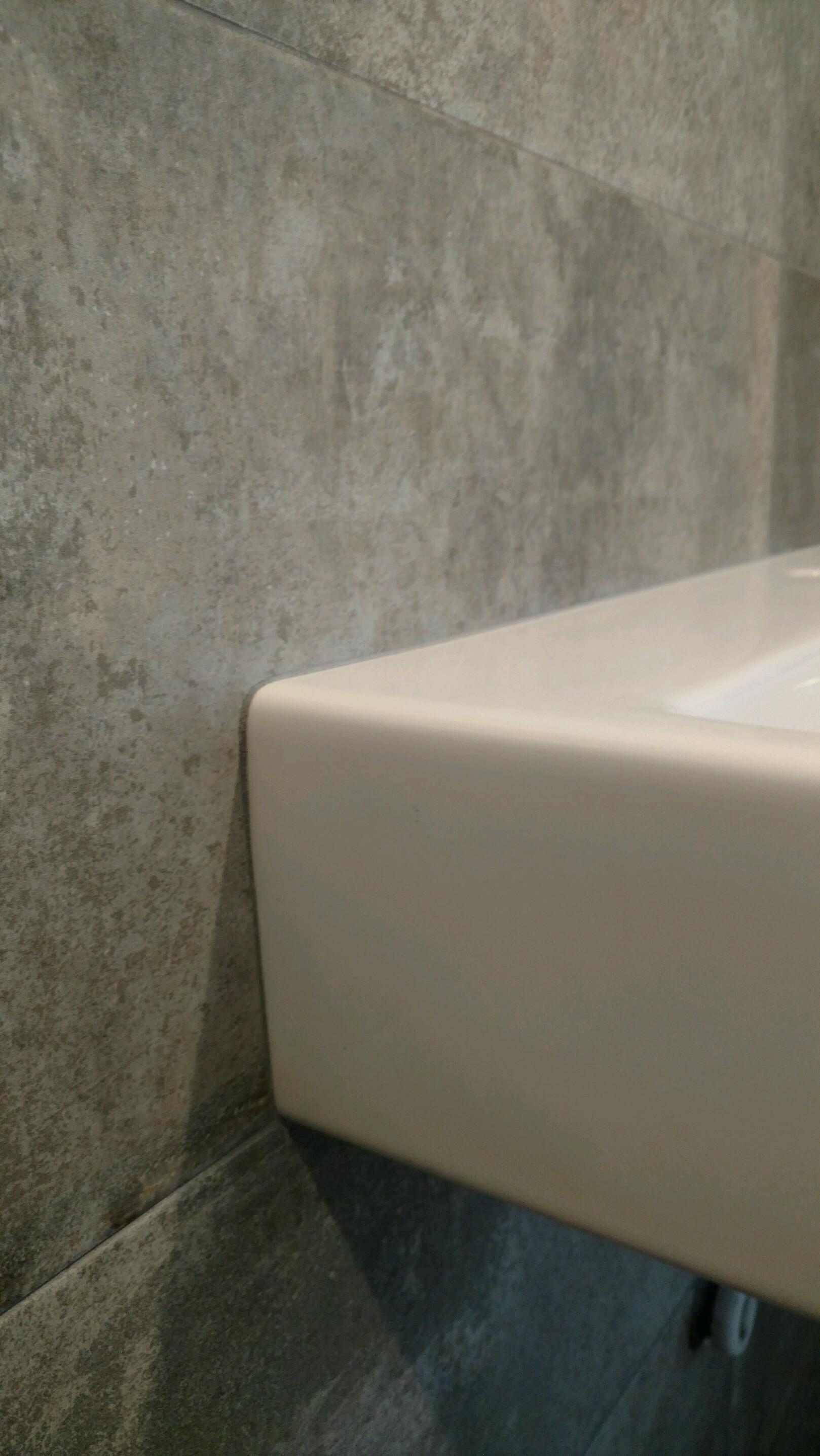detail cement look porcelain around white sink