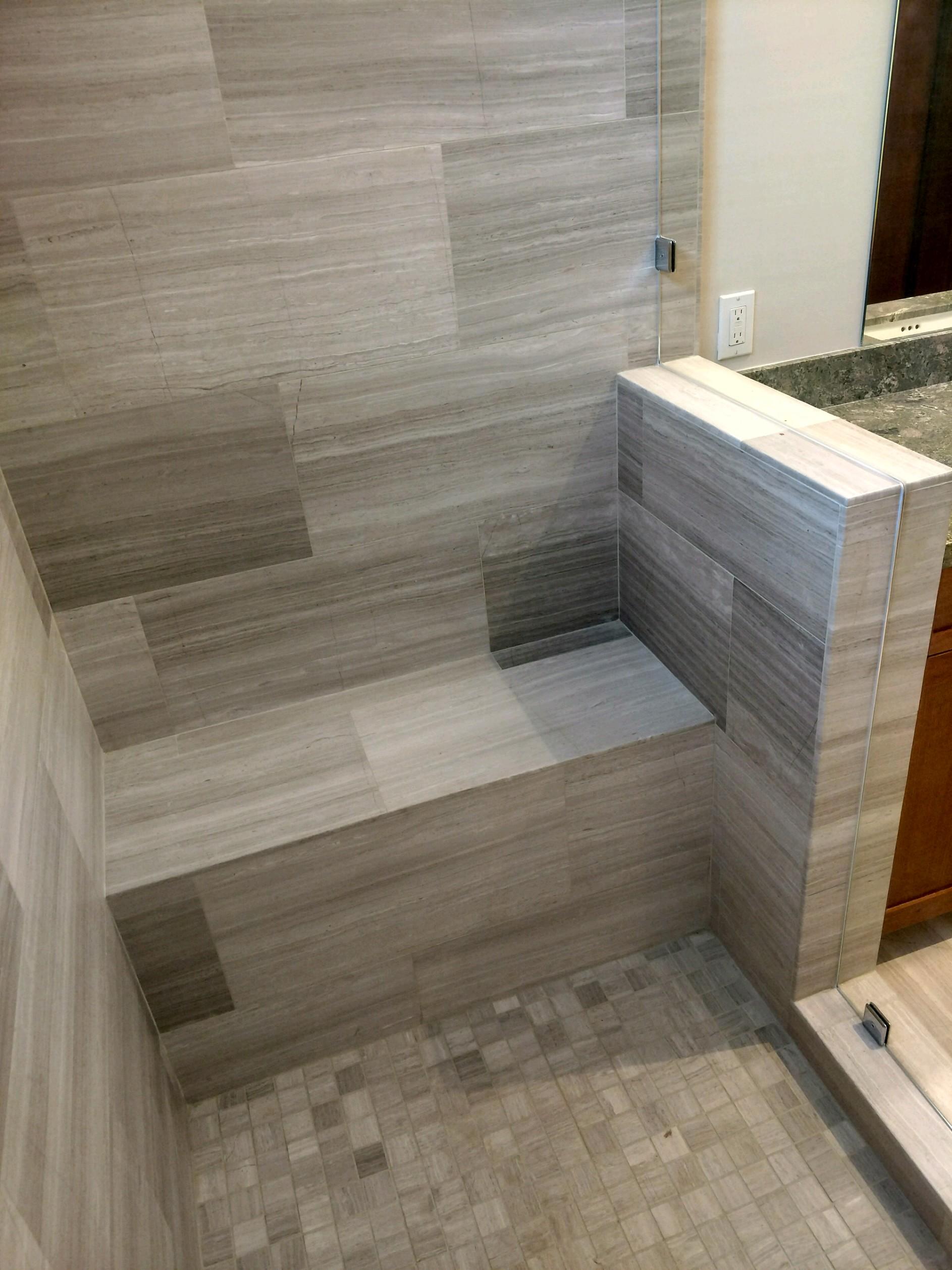 gray stone shower bench pebble shower floor