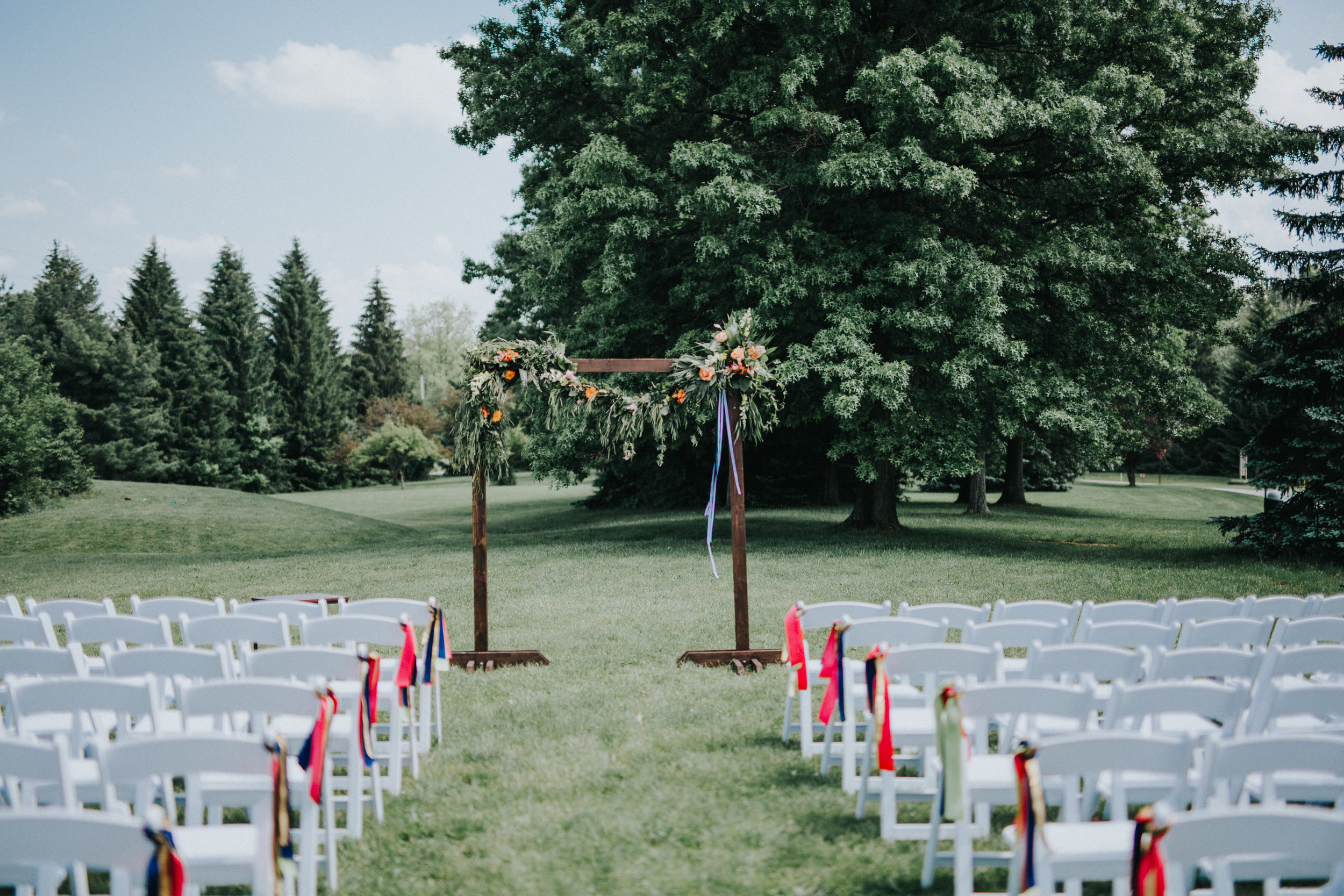 Heritage Barn wedding ceremony on the lawn