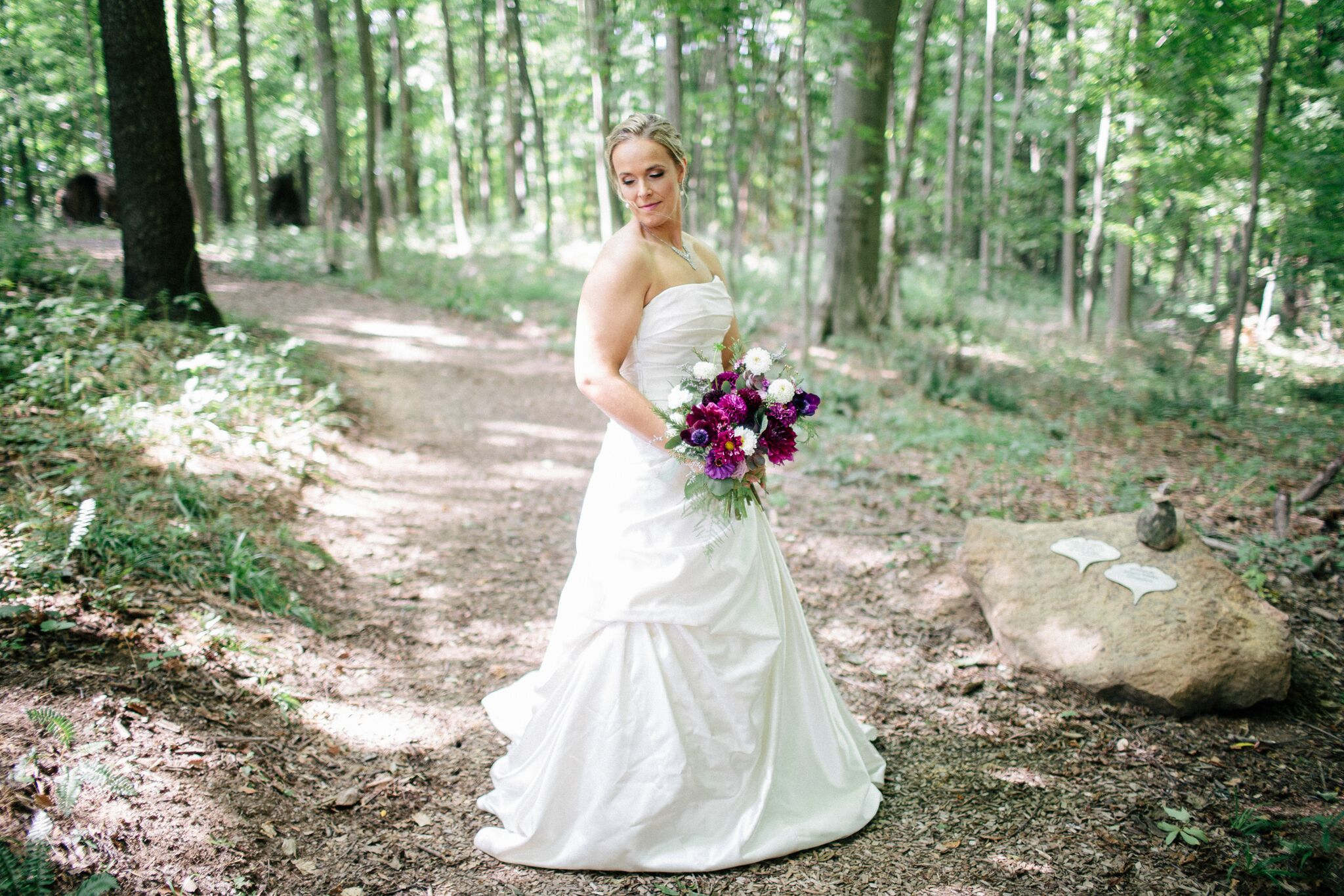 Bride in the woods at The Inn At Honey Run