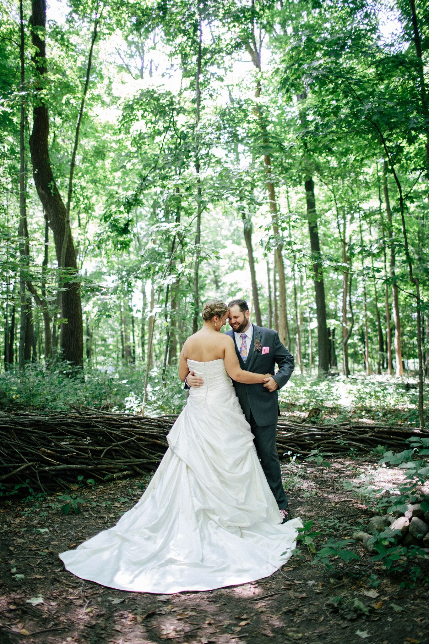 bride and groom in the forest at The Inn At Honey Run wedding