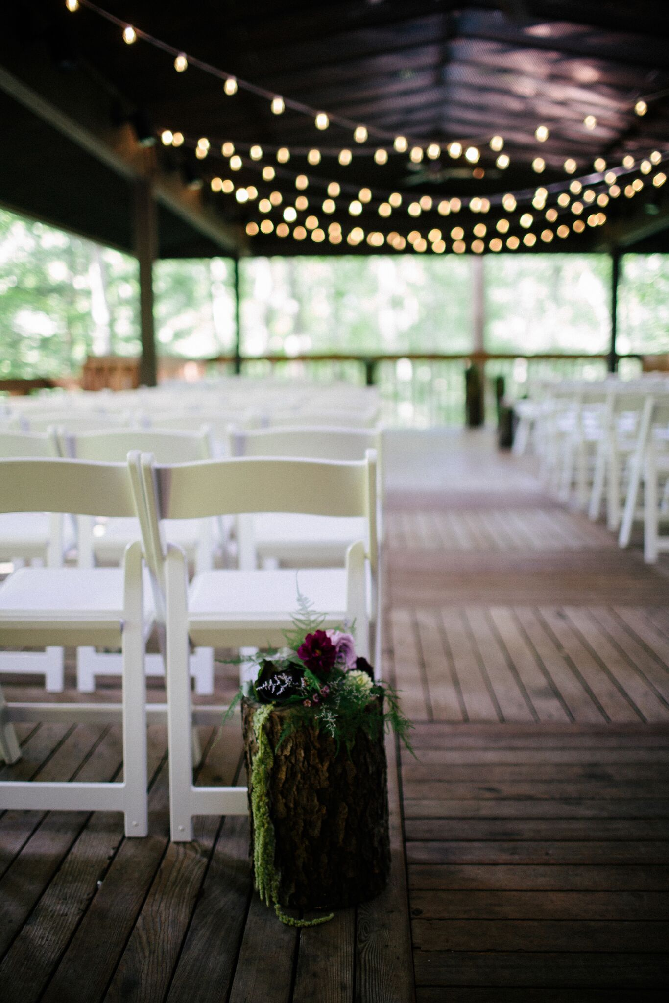 mossy log wedding ceremony decor