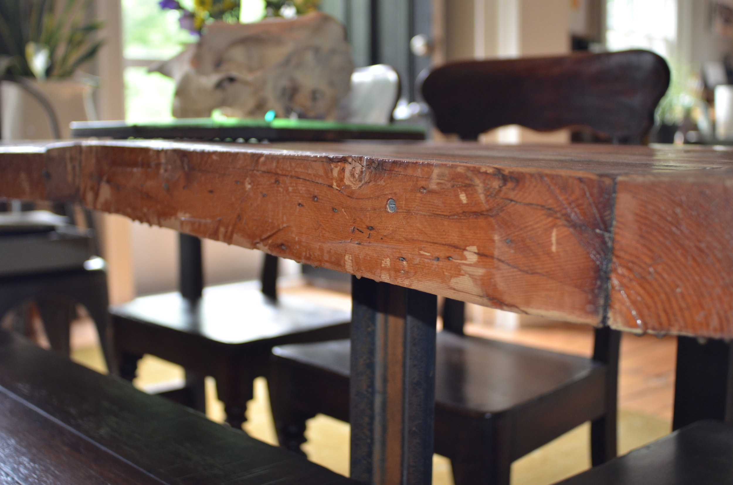 DETAIL OF RECLAIMED WOOD DINING TABLE