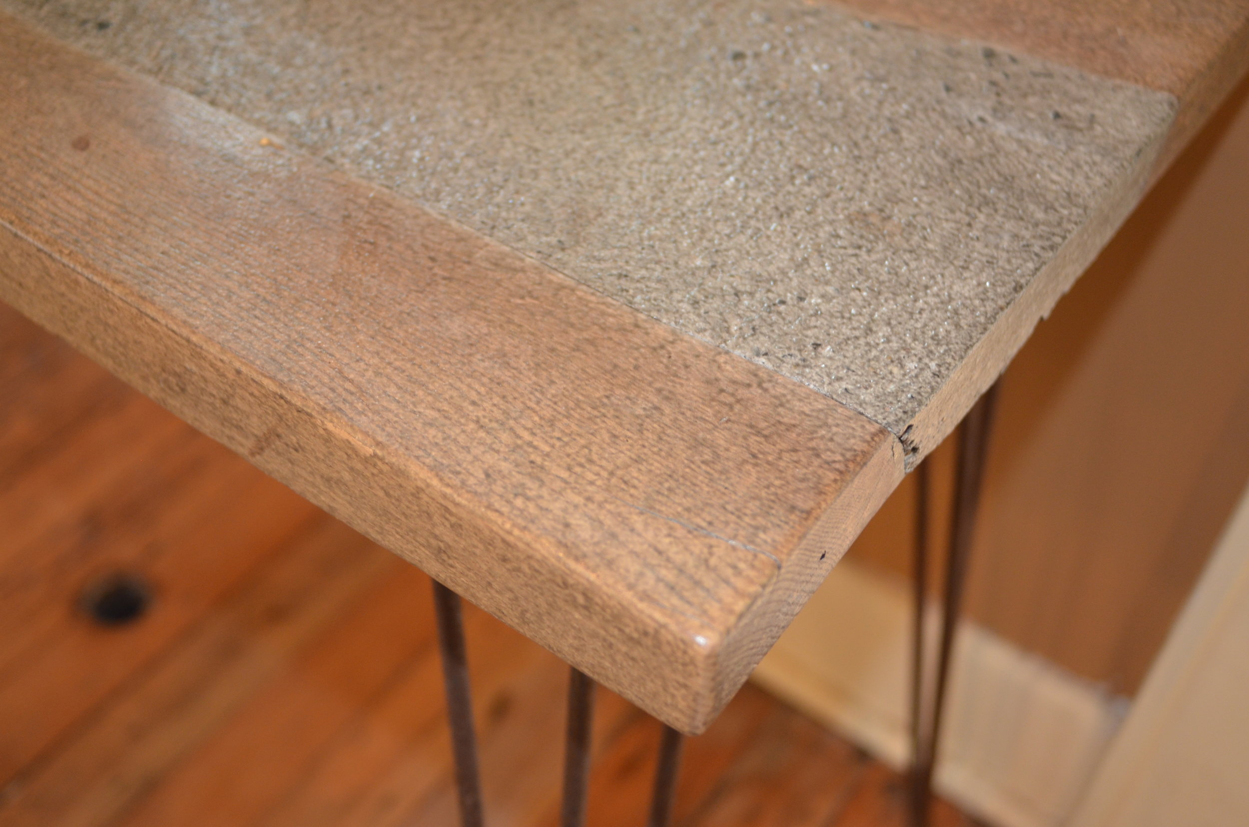 DETAIL OF CONCRETE AND RECLAIMED WOOD HAND-MADE SIDE TABLE