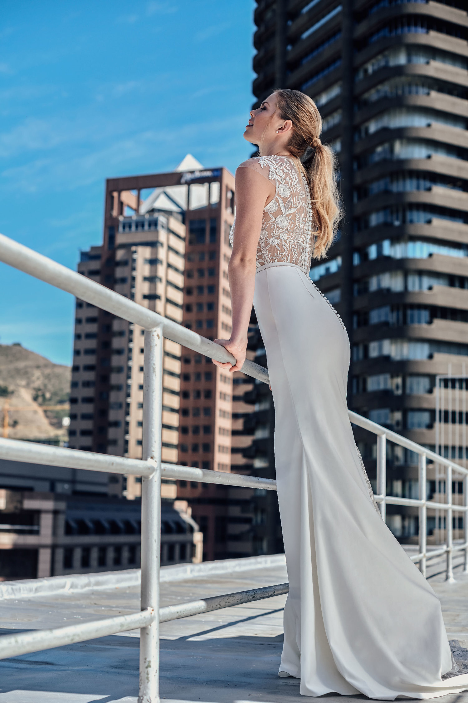 viola - The Viola Gown features a unique polo neckline for a modern take on Victorian style. A floral lace bodice is paired with a simple yet elegant white satin skirt that moves with you, and the floral lace train will make a dramatic impact from behind.