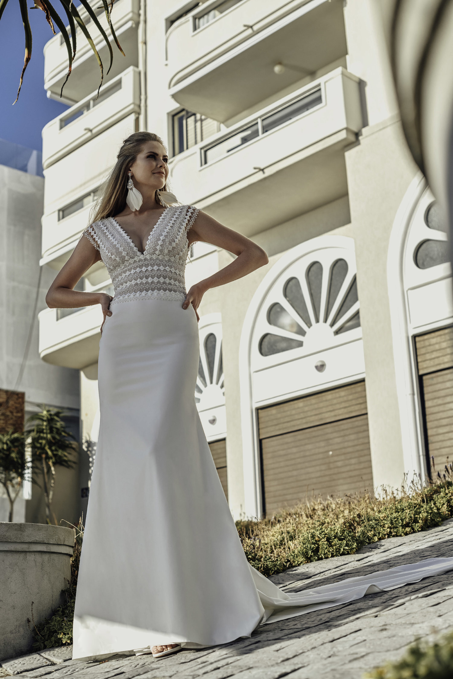 brunia - The Brunia Gown is a modern bride's dream. Pearl beading adds a soft shine to the macrame lace bodice, and the dropped waistline creates a slimming look. The white satin skirt is designed for optimal comfort and movement, whilst maintaining a clean elegance.