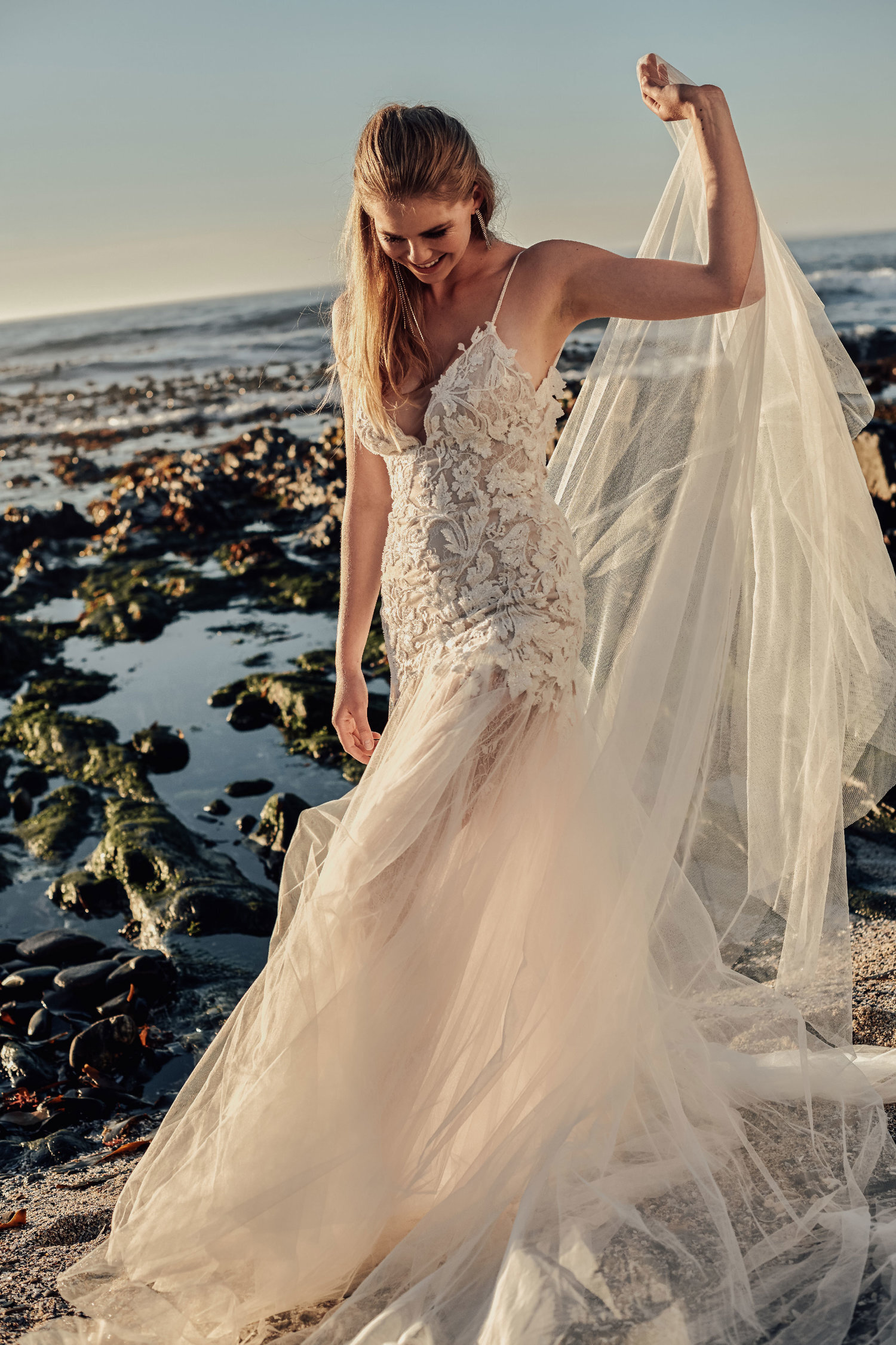 HEUCHERA - The Heuchera Gown our modern take on Art Nouveau, with beaded lace meticulously placed into a puzzle of floral grandeur. A deep plunge and low back flow into a mermaid style skirt and train, providing you with the perfect combination of a vintage and modern silhouette.