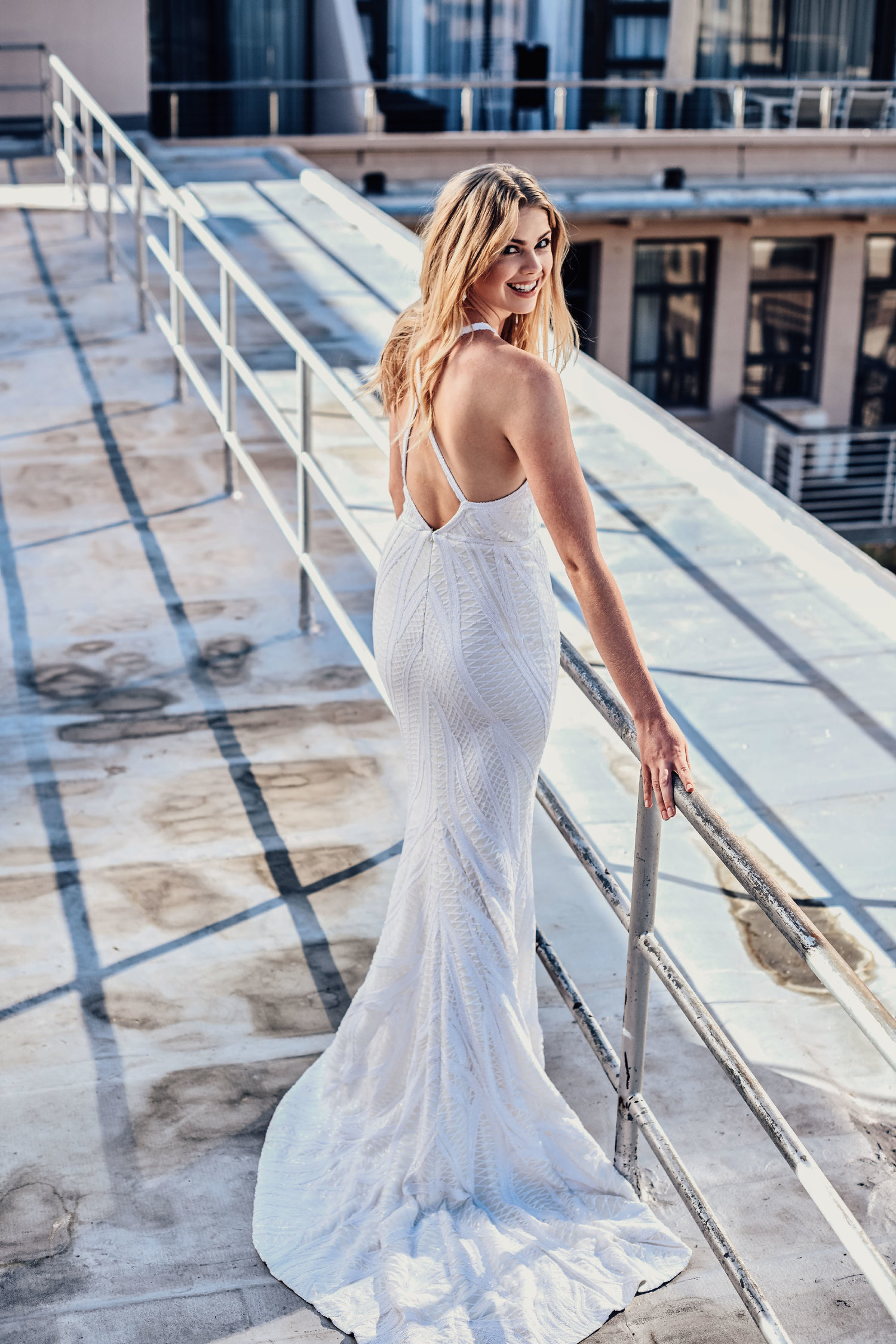 berberis - The Berberis Gown is designed with a halterneck to accentuate your shoulders, and lines of sequins draw the eye down the perfectly fitted shape. Move the way you want with a short train at the back, and high slit in the center front that exudes carefree glamour.