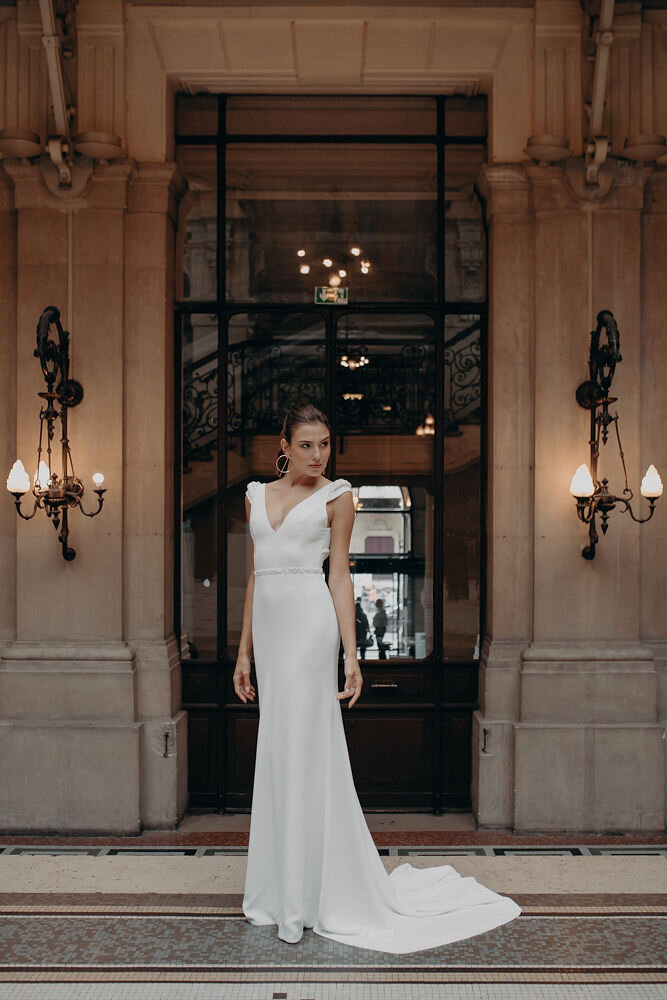 orchid - The Orchid gown elegance in simplicity. Made with a soft matte crepe, this figure-hugging dress provides a sophisticated silhouette that has the option of crepe cap sleeves or hand-beaded cap sleeves and belt for a more dramatic detail.Colour - Ivory / Sizes - 6-24