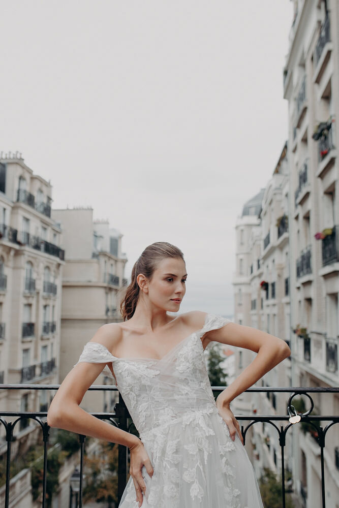 ivy - The Ivy gown flatters on all bodies. A structured crinoline corset provides support and comfort, and delicate tendrils of flowery lace drape your body and cascade down over a smoky tulle skirt. The off-the-shoulder cap sleeves and low back complete this classically romantic look.Available in the Original Smoky Blush Ivory, Pure Ivory or Blush Ivory / Sizes - 6-24