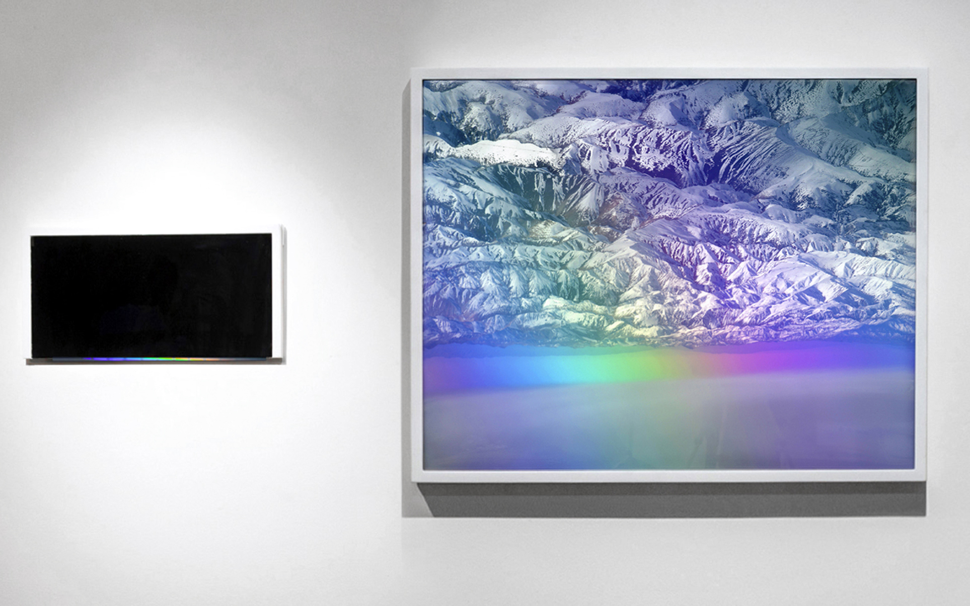 "Horizon , 35"" x 40"" and 9"" x 18"", Framed inkjet photograph, cut beveled mirror, light, reflection (spotlight creates a prism on the mirror bevel), 2012. Collaboration with Carlos Vela Prado"