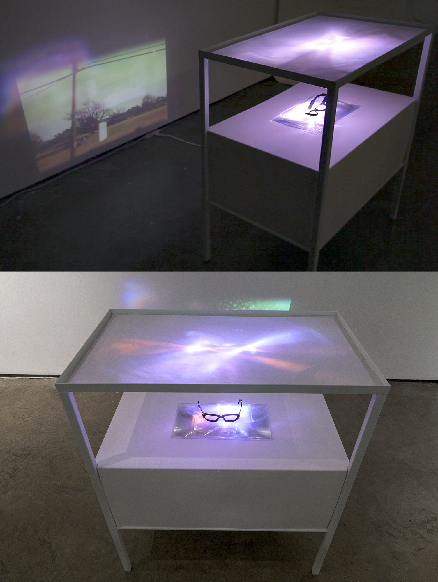 Train to Niebla , custom table sculpture housing a digital video projection. Video is projected onto angled mirrors (inside bottom shelf) that project the video both onto the facing wall and up through the magnification of my father's reading glasses onto a tabletop of frosted plexiglass. The image seen on the plexiglass is refracted into spiraling points of light, an abstraction of what can be seen clearly on the wall. Digital projector, steel table, sintra, frosted plexiglass, fresnel lens, fathers glasses. Dimensions variable. 2012. Collaboration with Carlos Vela Prado