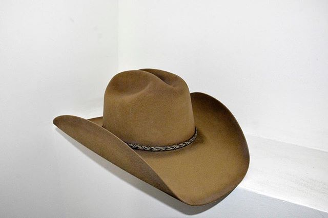 """With the current vogue for western hats and hat making, questions have arisen about what makes a hat ""authentic."" Style, material, and contemporary customer preference are all critical factors, yet when it comes to what defines authenticity, one true answer may not exist.  This modern iteration of the Boss of the Plains, courtesy of Stetson Worldwide, exemplifies a more typical cowboy shape compared to its open crown predecessors and features distressing at the brim, hatband, and crown."" - Marisa Lujan (@marisa_lujan)  Image: Boss of the Plains Hat, Stetson Worldwide, 2018, designed 1865. Courtesy of Stetson Worldwide. Photographed by Aanchal Bakshi for NYU Costume Studies, 2018. Image © Aanchal Bakshi."