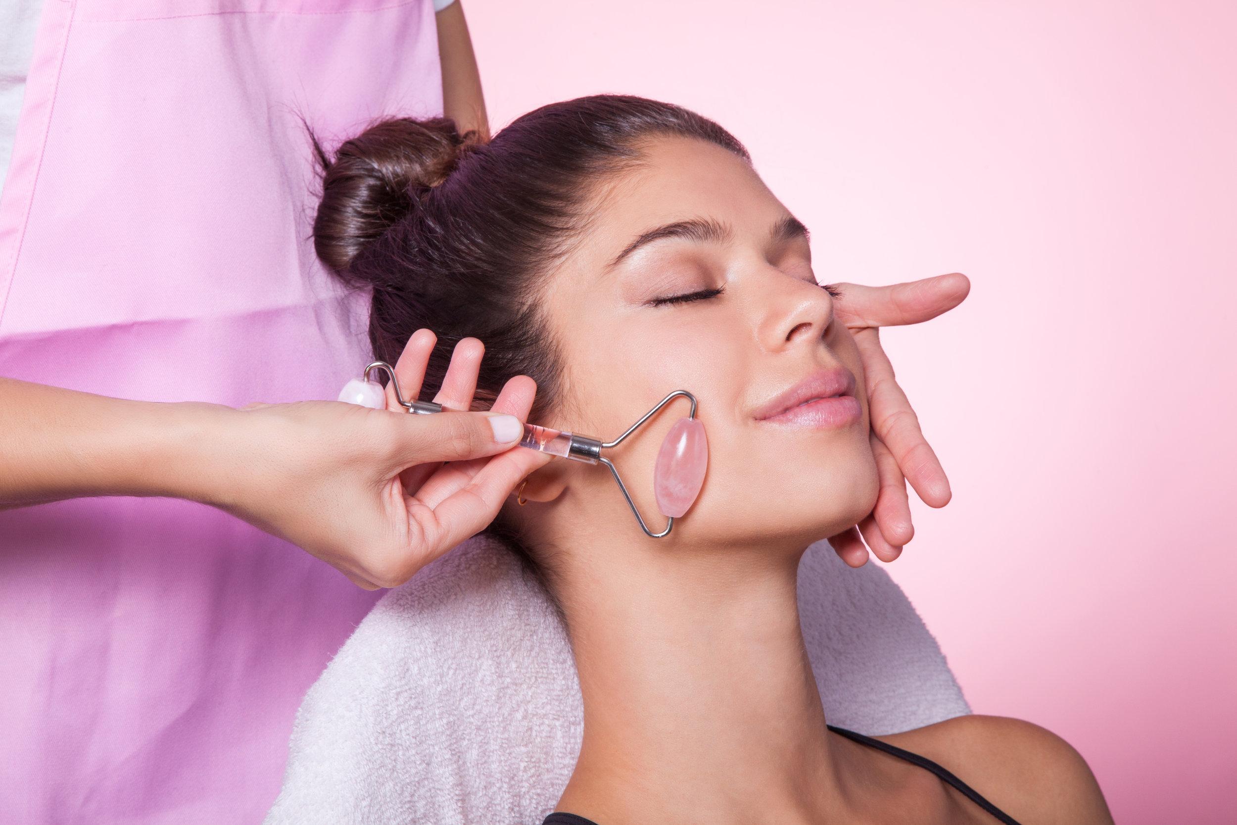 Woman Using Facial Roller