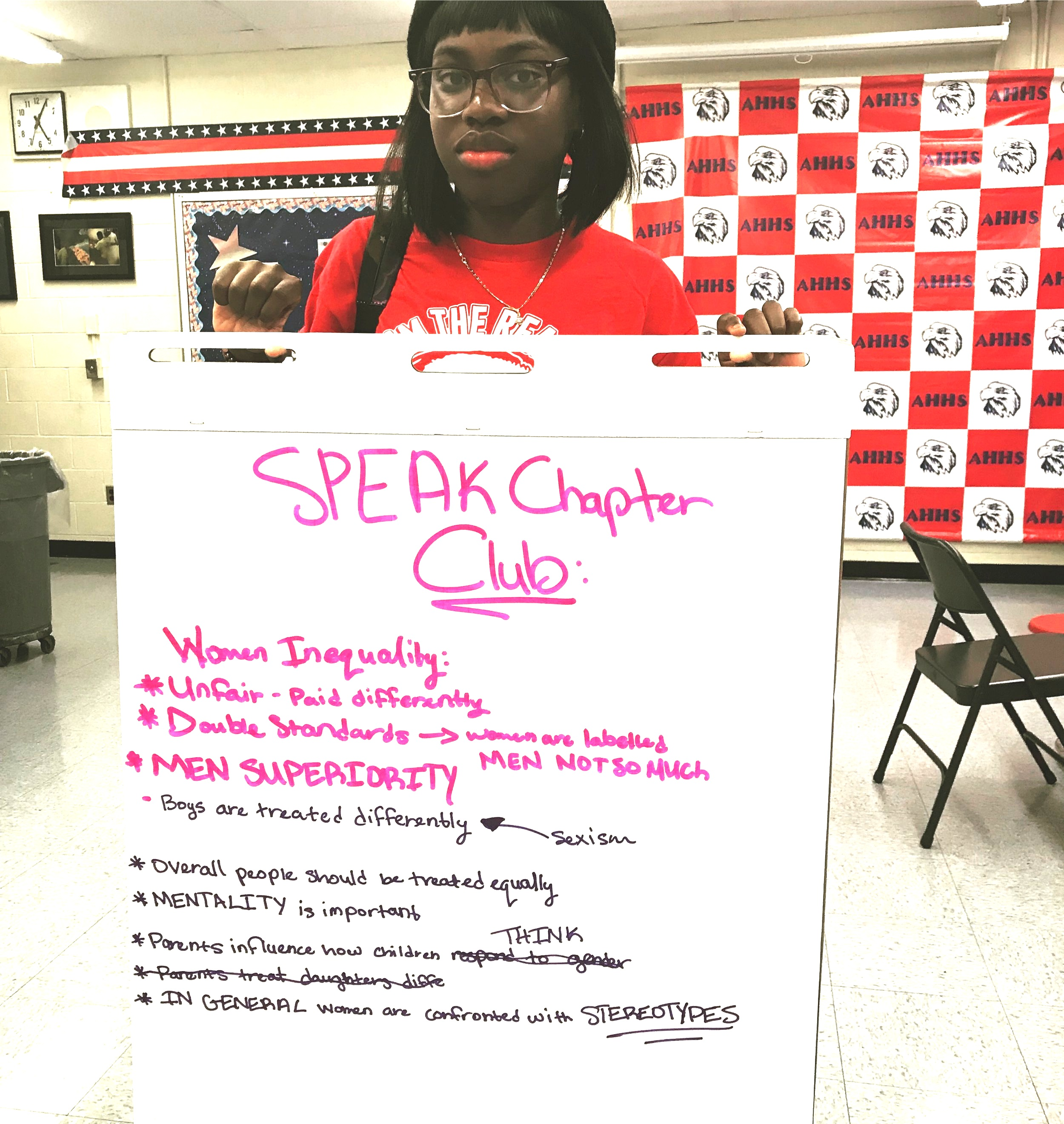 '18 Ambassador, Ayoko, at a high school in Newark, New Jersey, presents the key takeaways from a discussion she led at her SPEAK Chapter Club around issues facing women.