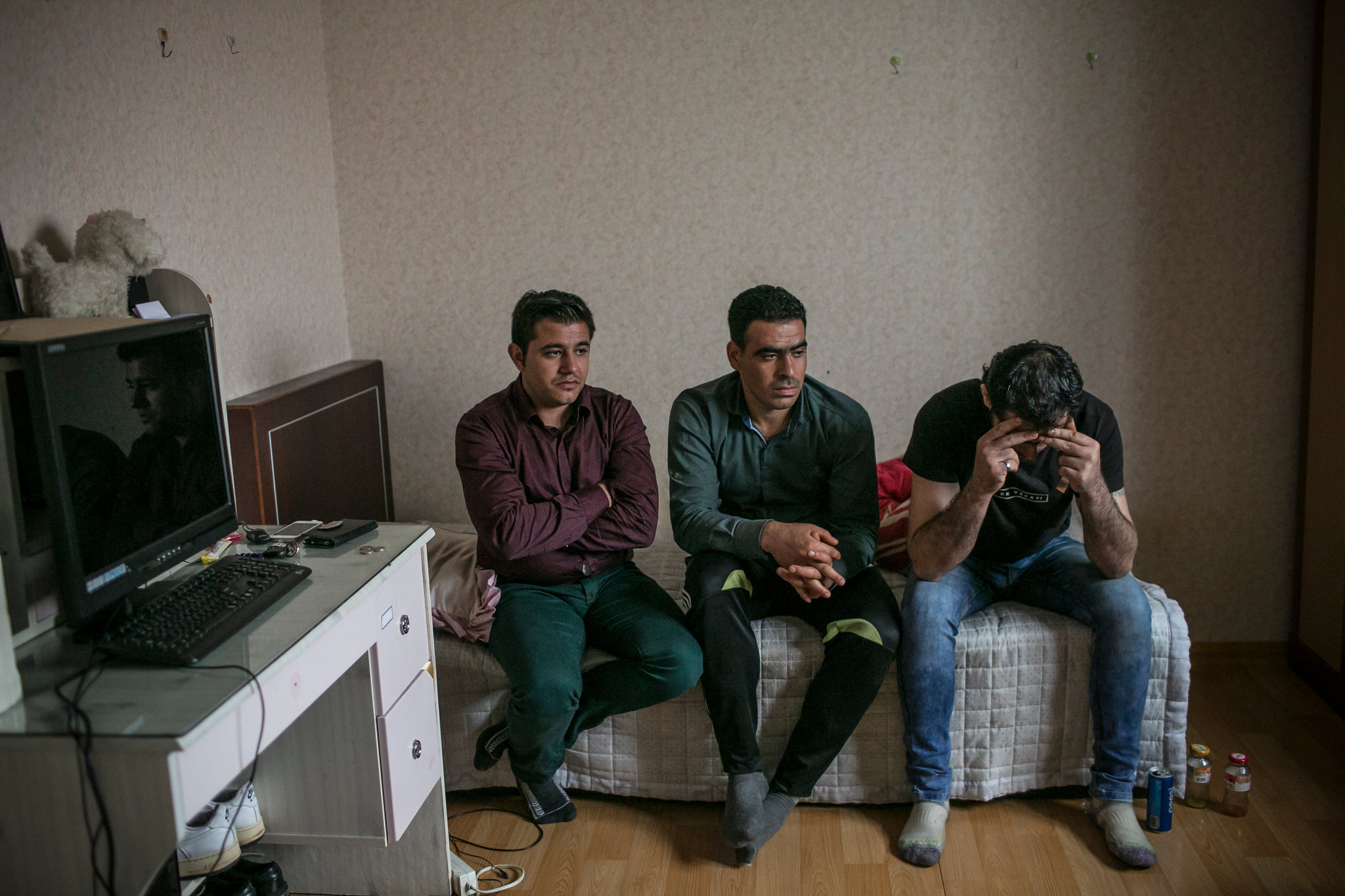 Ahmad Barro, left, Ahmad al-Othman and Ahmad Khalifa last month in Yangju, South Korea. The men, all from Syria, expressed frustration as they talked about family members left in Aleppo. Credit - Jean Chung for The New York Times.
