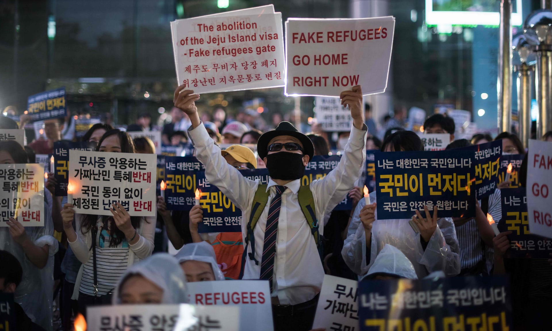 South Koreans protesting against the refugees. Taken from News article by the South China Morning Post -    https://www.scmp.com/magazines/post-magazine/long-reads/article/2155163/influx-refugees-yemen-divides-south-korean-resort