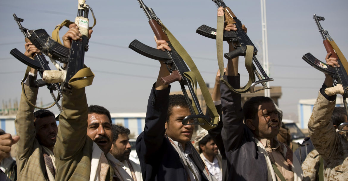 Houthi Shiite Yemeni raise their weapons during clashes near the presidential palace in Sanaa, Yemen, Monday, Jan. 19, 2015. (AP Photo/Hani Mohammed)