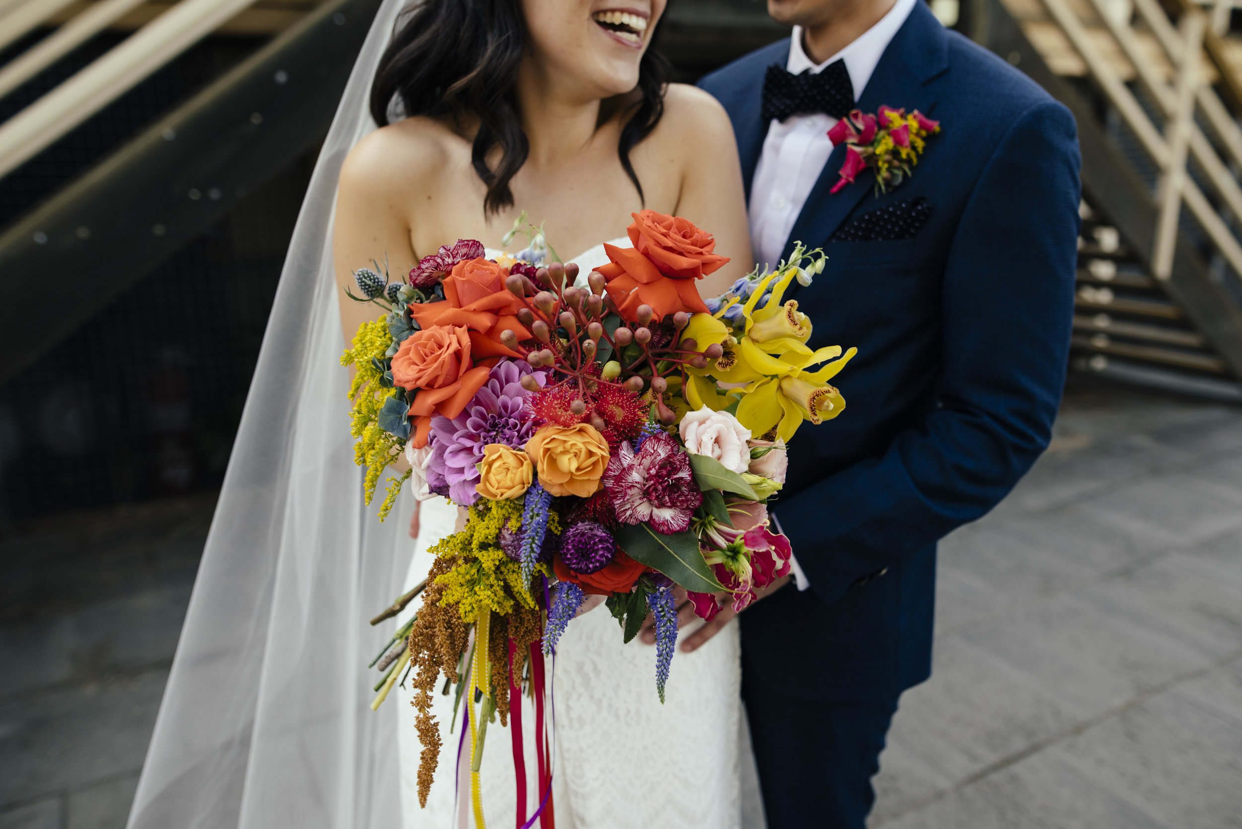 Diana & Steve   Venue: Footscray Arts Centre  Bold, bright and fun colours to create exciting and different bouquets.  Diana & Steve drew inspiration from Mexican fiesta.    Photographer: Motta Weddings