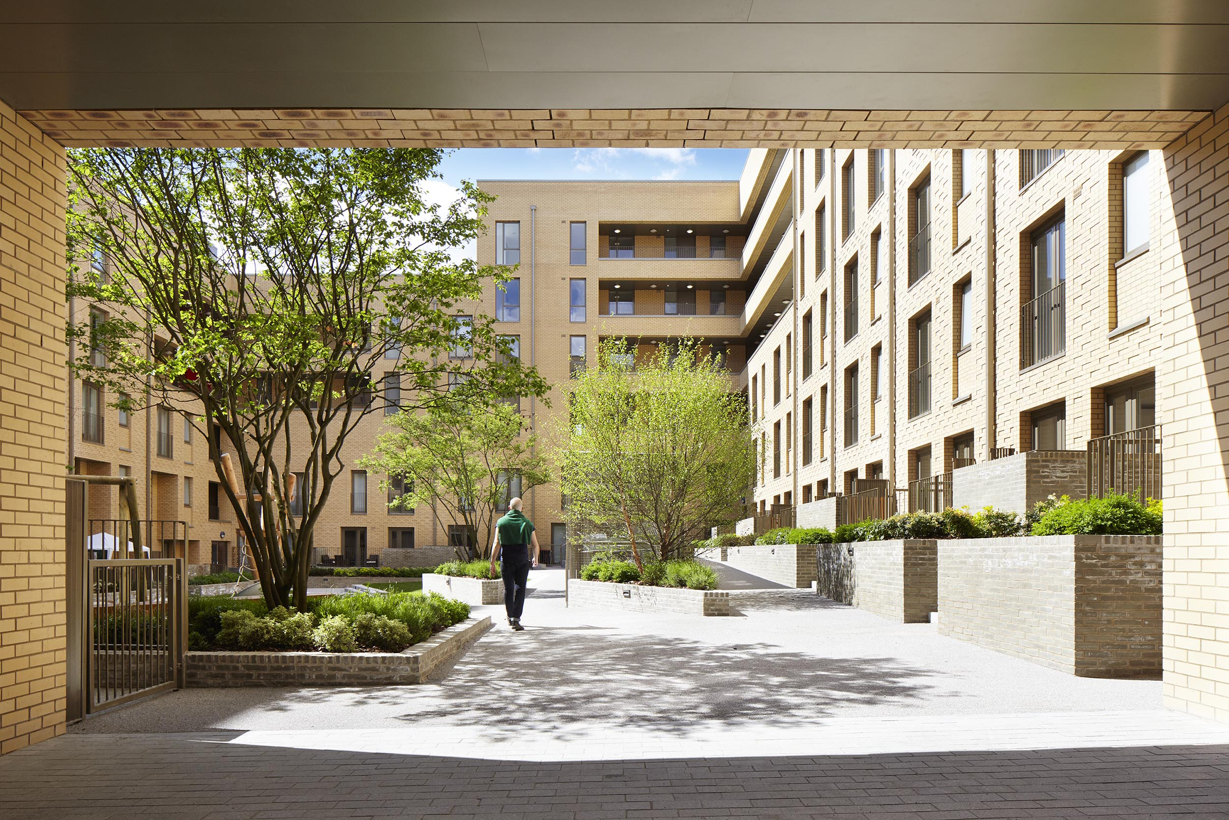 Shared courtyard provides green space for private and social tenure homes; photo ©Jack Hobhouse.