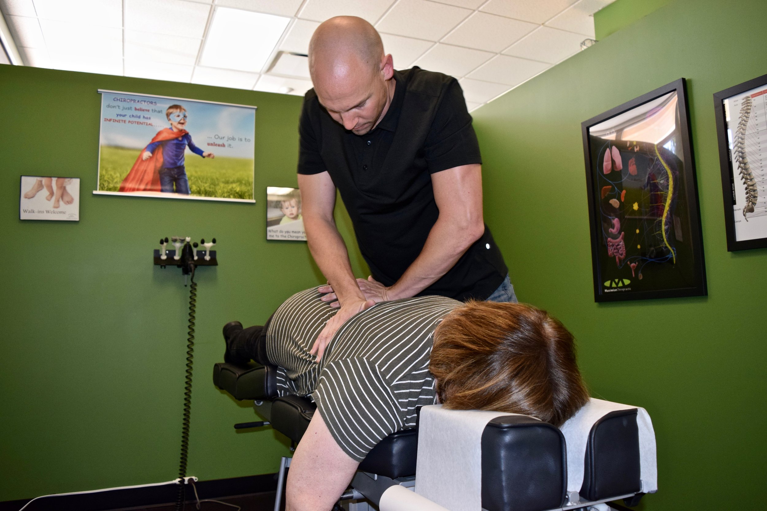 Max Chiro Dr TIm Hand Adjust Female Patient  2.jpg