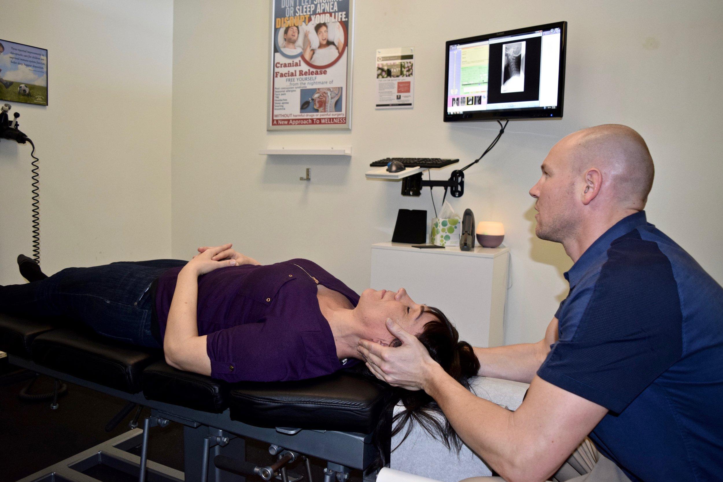 Dr Tim Neck Adjust Patient 2.jpg