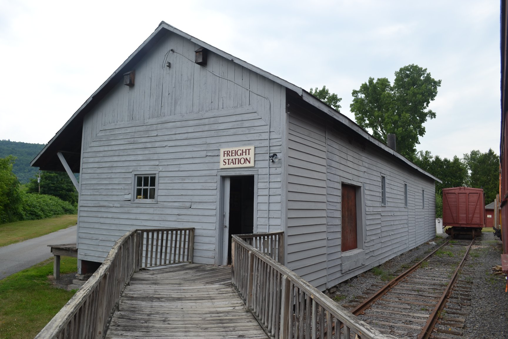 Schoharie Valley Railroad Museum : Features Main complex: Station House, Freight Shed, Engine House, Weigh Station & the Old Mill Bldg. Restored 1891 passenger car & 1917 wooden caboose.