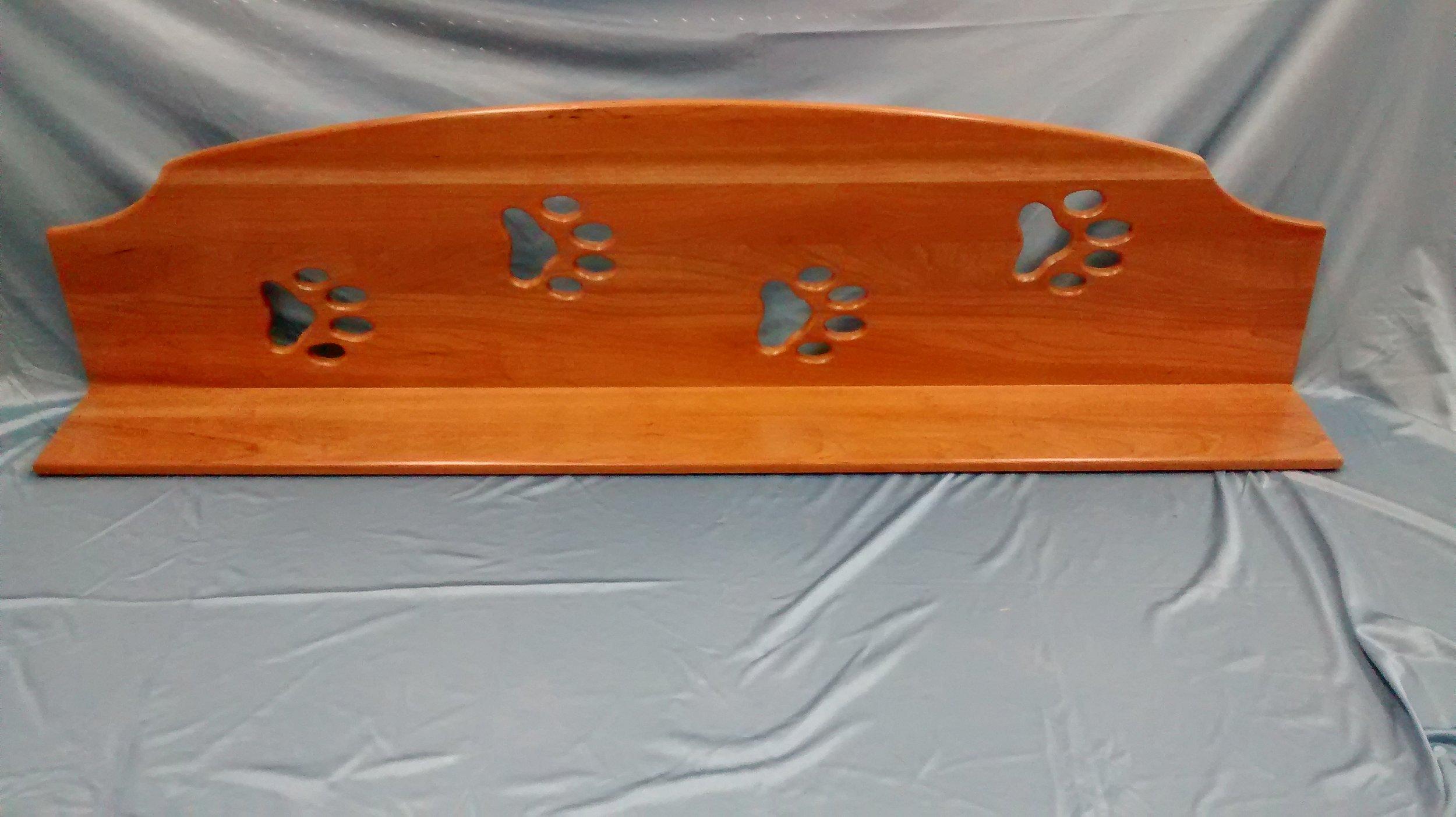 Shelf with Four Dog Pawprint Cutouts