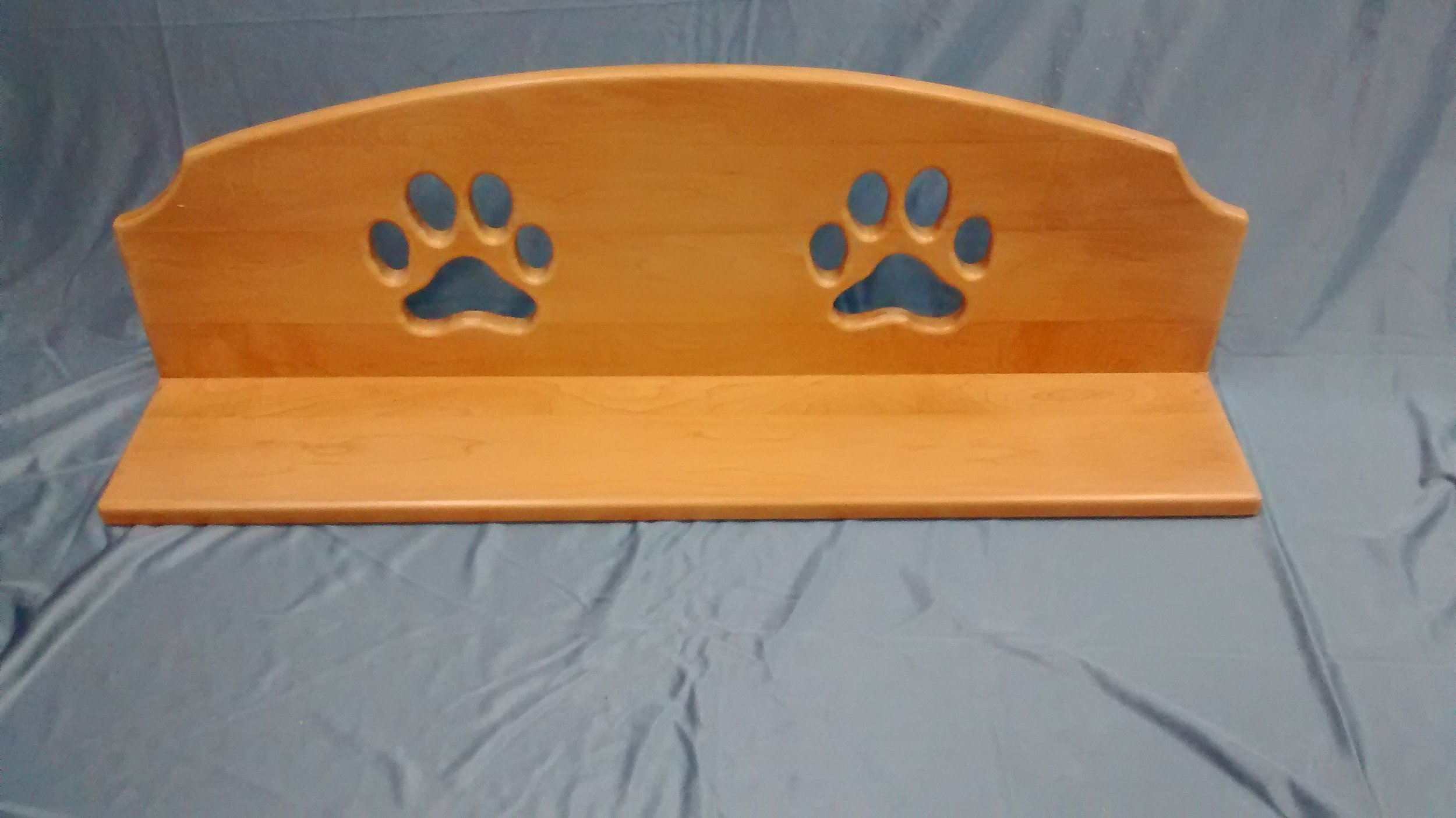 Shelf with Two Dog Pawprint Cutouts