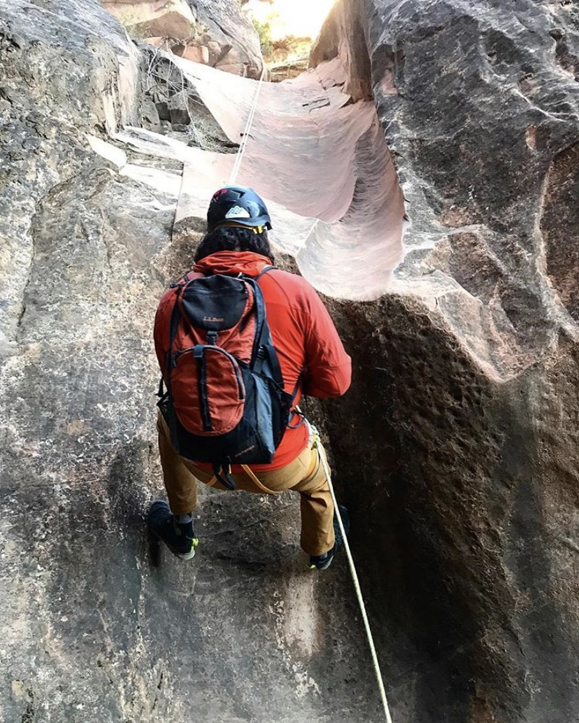 Andy rappelling through a slot canyon