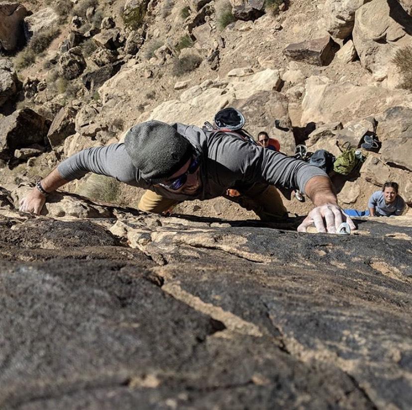 Xavier climbing at a local Utah crag