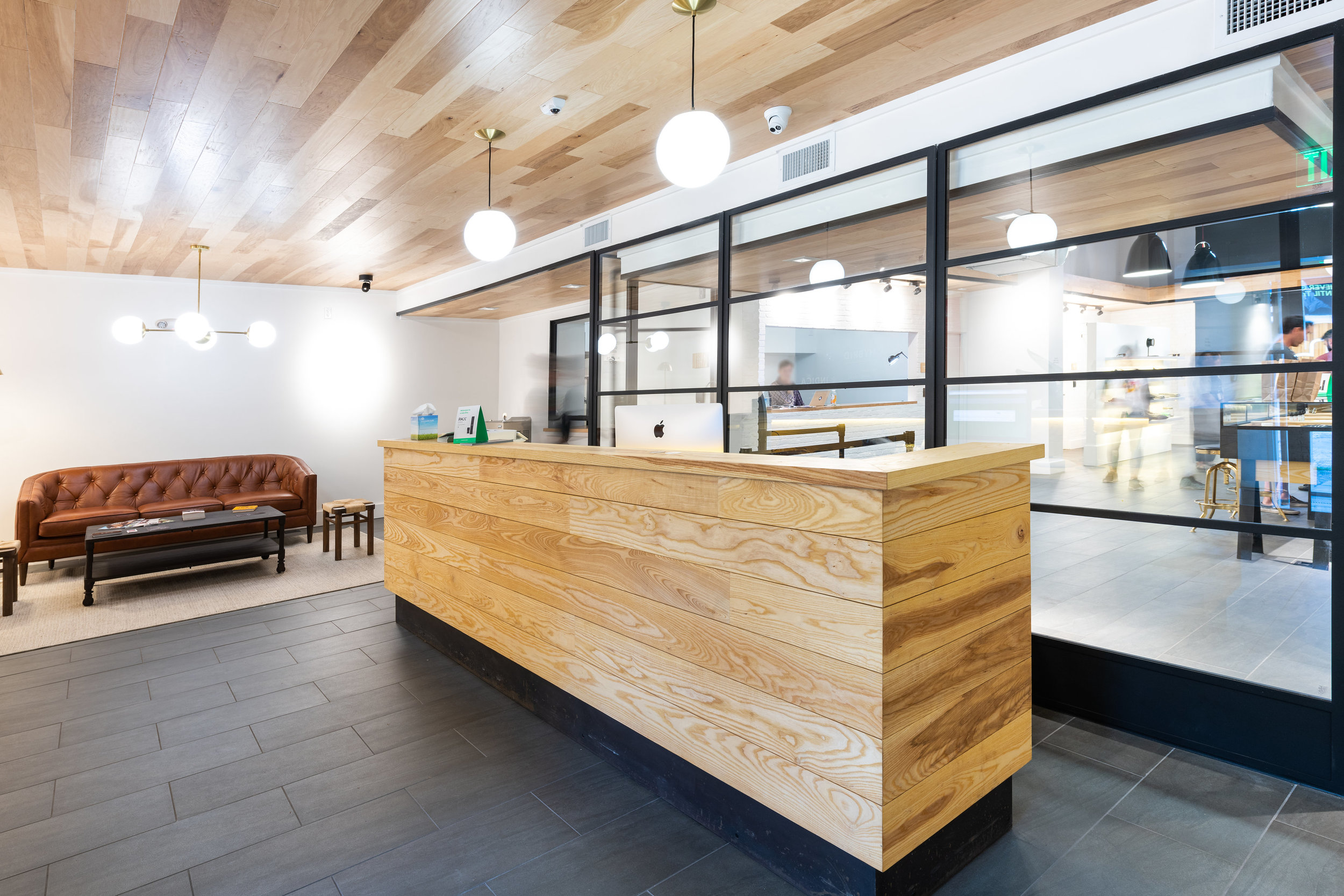 Ash reception desk for Storehouse Dispensary in Baltimore, MD. Designed by SM+P Architects