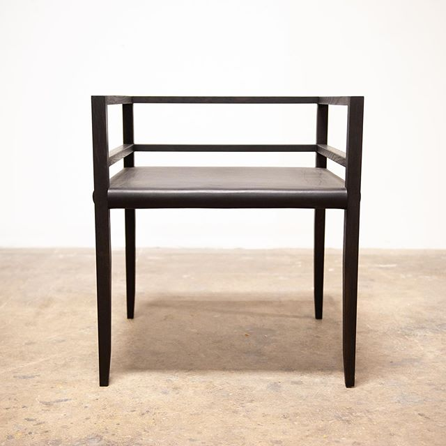 Black leather + black oak. Cale dining chair. #olivrstudio