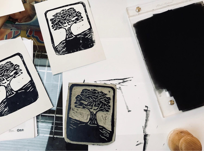 Linocutting a logo for Manifest -
