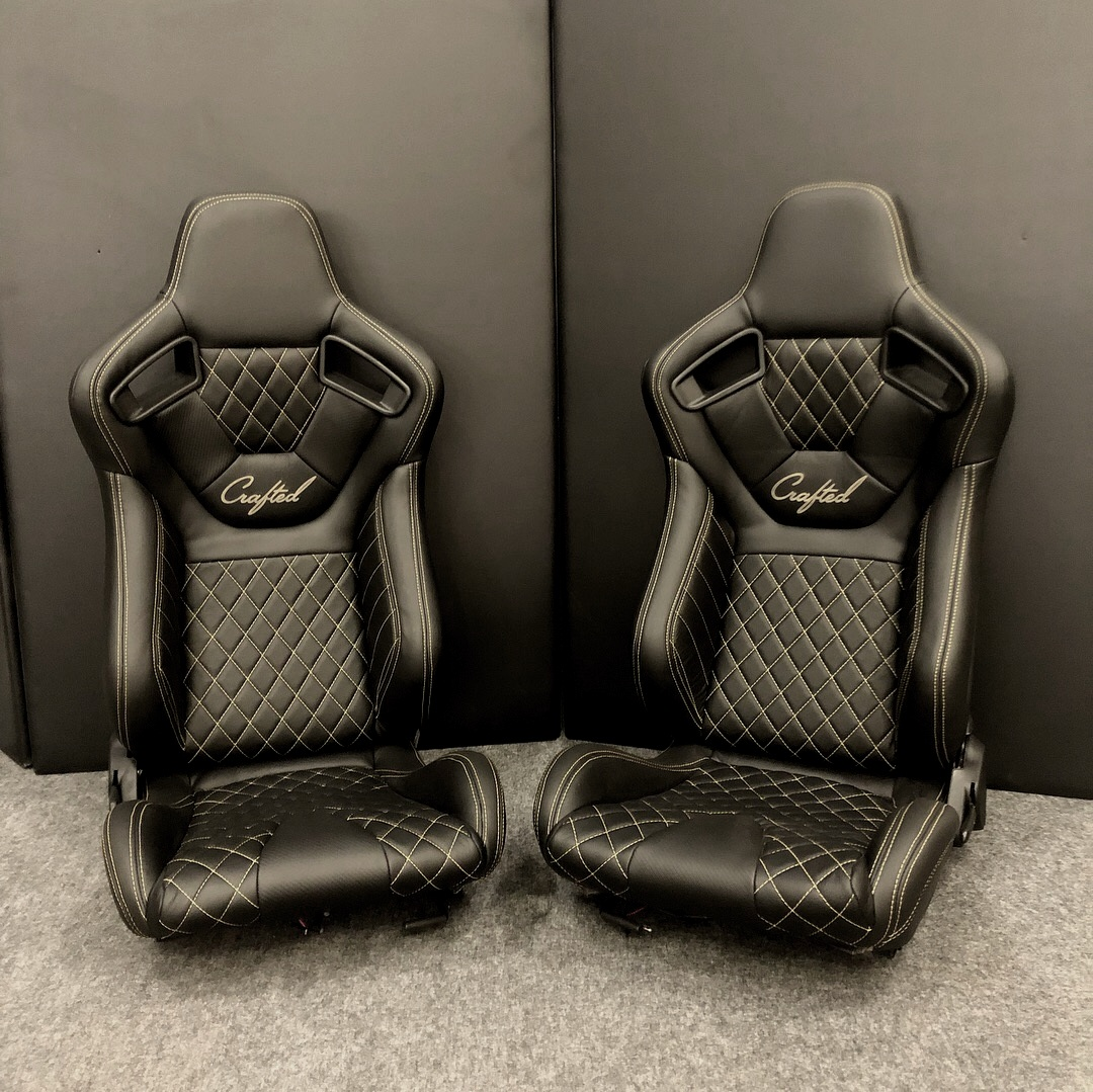 NW Crafted's Custom Black leather racing seats with white diamond stitching.