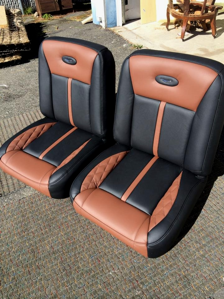 Custom Black and tan leather bucket seats with a tan diamond stitching accent.