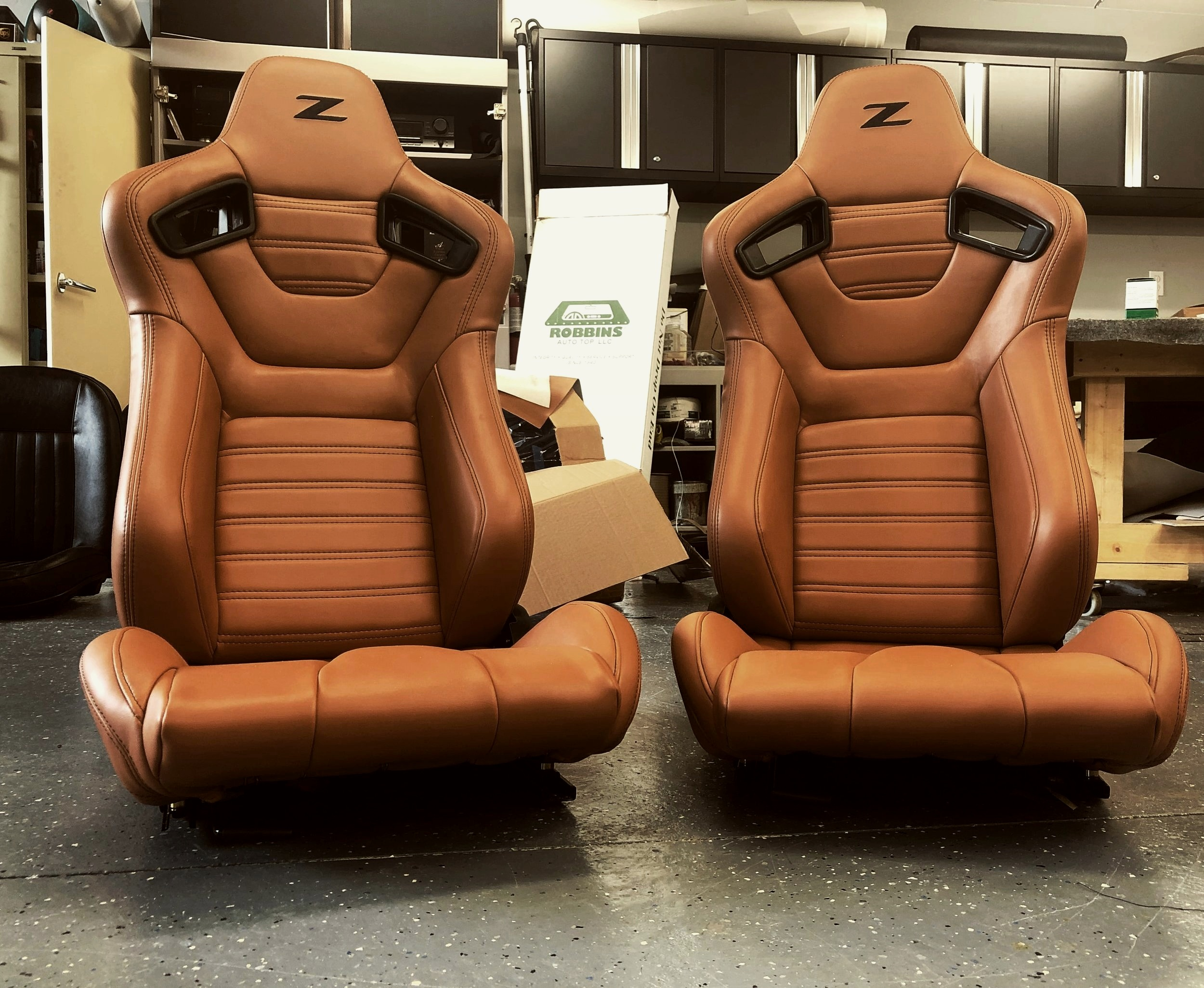Custom tan leather racing seats.