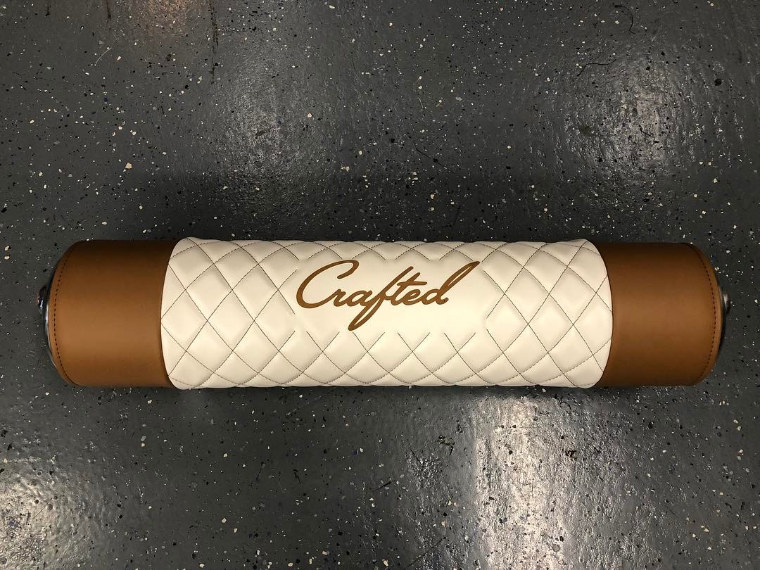 NW Crafted  cares about every detail down to your tank wraps.  Check out this Crafted tan and white leather tank wrap. Complete with the Crafted Logo and diamond stitching.